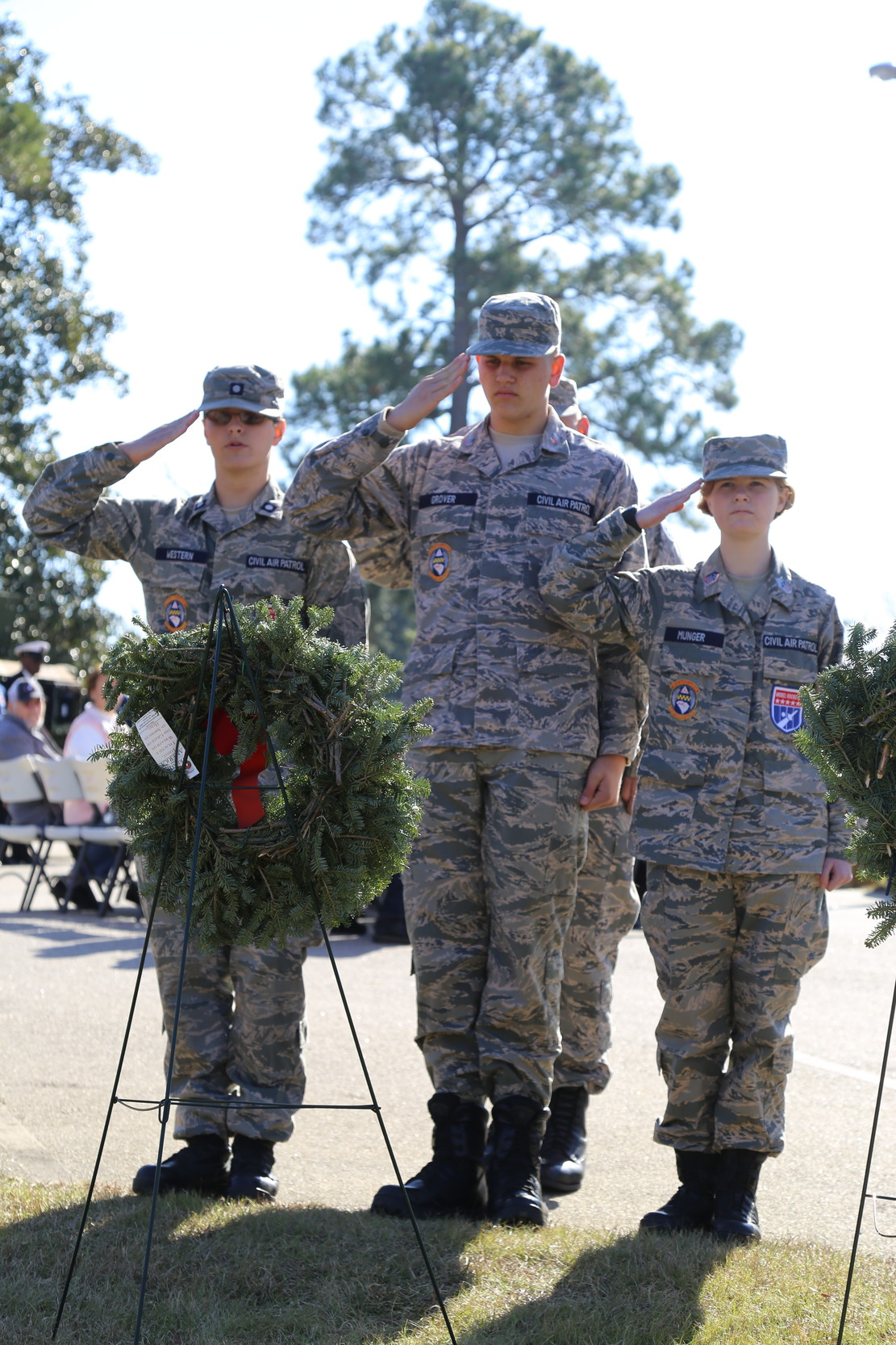 Members of Sumter Civil Air Patrol salute after placing a wreath on Saturday.