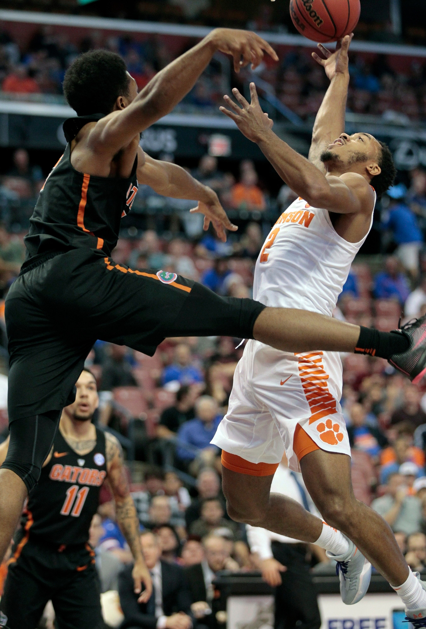 Clemson's Marcquise Reed (2) shoots over Florida's KeVaughn Allen during the Tigers' 71-69 victory on Saturday in the Orange Bowl Classic in Sunrise, Florida. Clemson plays host to rival South Carolina today.