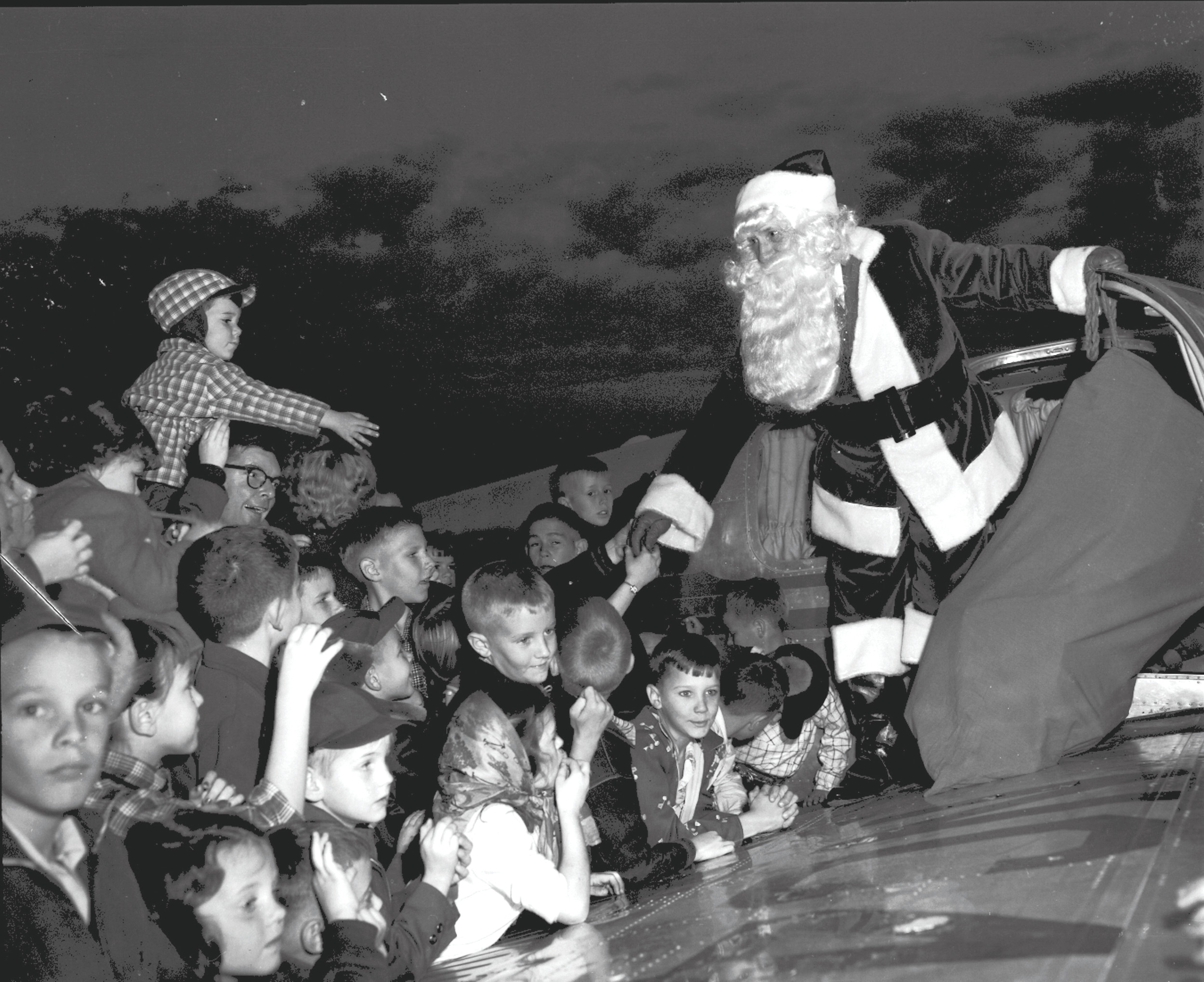 Santa was transported to Sumter in the 1950s in an airplane provided by the owner of Coca-Cola Co. to greet a crowd of children from the city at the local airport.