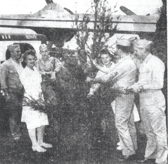 Cpl. Charles Shipley, of Sumter, third from left, is seen with a group of wounded and hospitalized Marines as they examine a Christmas tree on its arrival at the Naval Air Station, Honolulu. The tree was complete with tinsel and ornaments. Others are, from left, Cpl. Thomas English, USMCR, Atlanta; Ens. Dorothy Goodrich, Falls Village, Connecticut, Navy nurse; Cpl. Shipley; Ens. Evelyn Kasznia, South Bend, Indiana, a Navy nurse; Cpl. Elmer R. Tyrce, Beckley, West Virginia; and Lt. Commander John