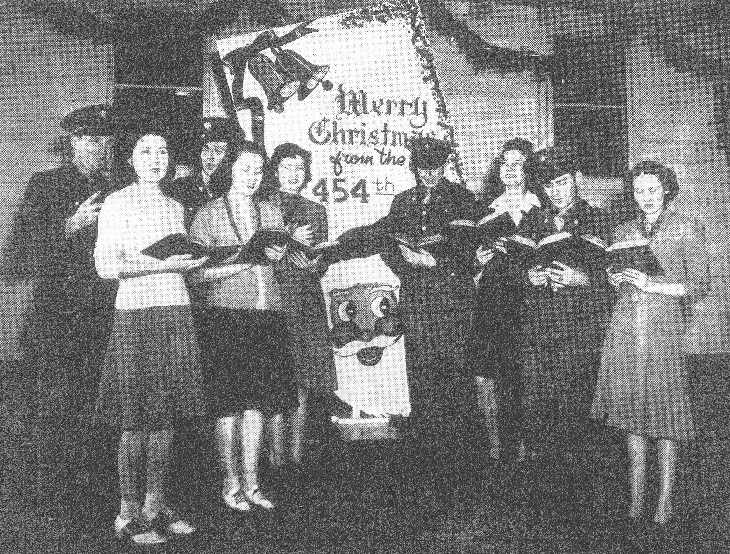 Soldiers and civilians join voices in welcoming the yuletide at the Army's Basic Flying School at Shaw Field. Gathered in front of one of the squadron dayrooms to sing out their greetings are Pansy Howell, Mary Elizabeth Rigby, Sherry Hook, Margarita Baldwin and Claire Gregg, all post headquarters employees; and Staff Sgt. Jack Lewis, Cpl. Vincent Sherwin, Cpl. Bill Jones and Pvt. Buster G. Thornton, members of the 454th Flying Training Squadron.