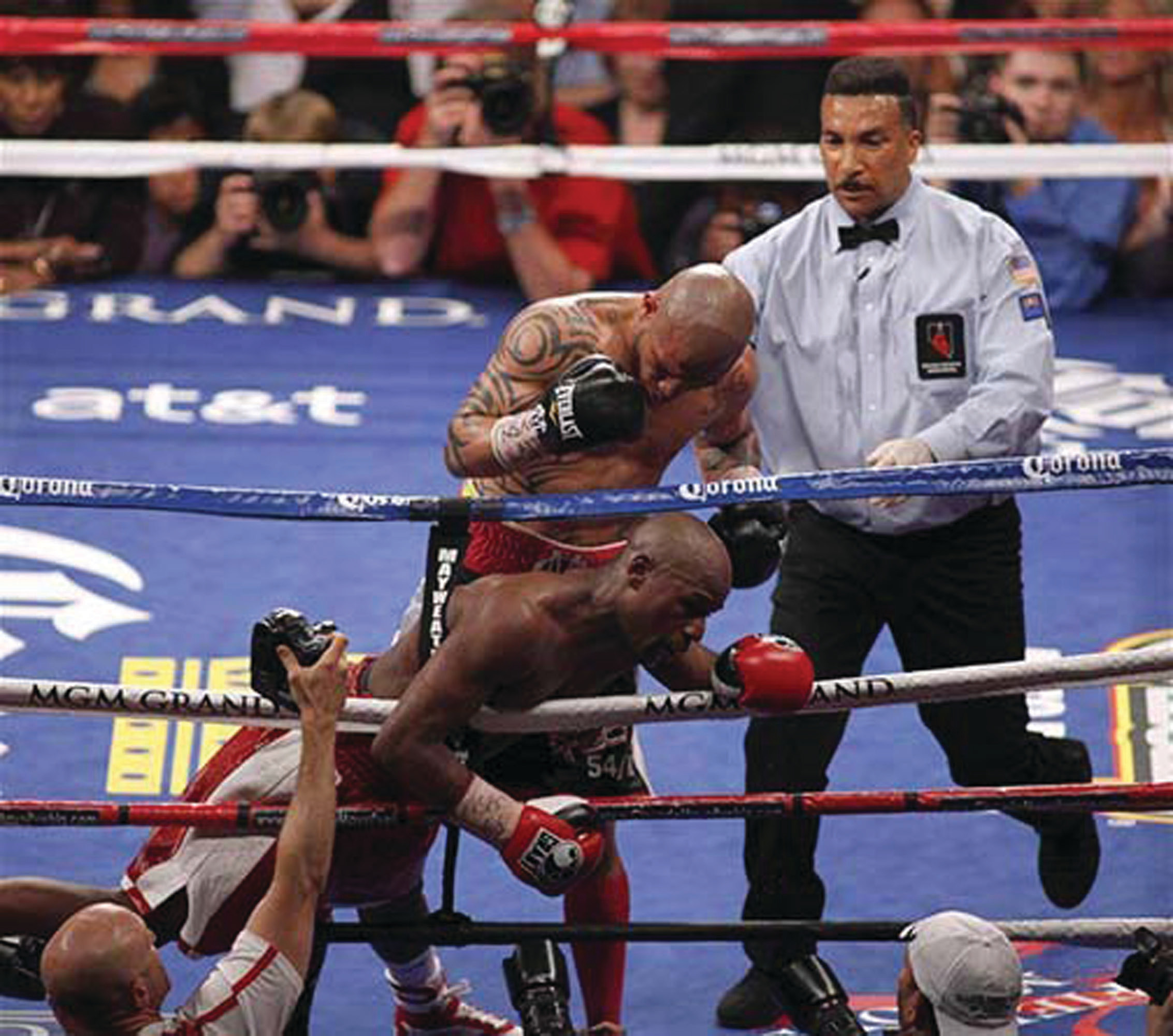 Internationally known boxing official Tony Weeks is shown in the ring with Floyd Mayweather and Miguel Cotto. Floyd Mayweather won the bout on May 5, 2012, and the Boxing Association's light middleweight title.