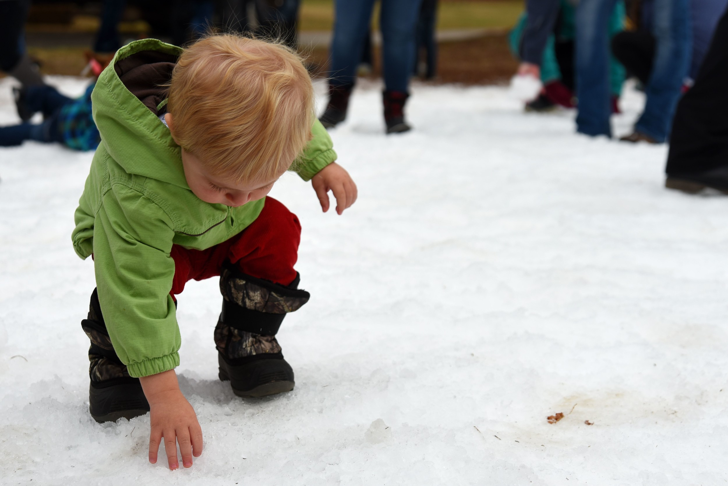 U.S. Air Force photos by Airman 1st Class Kathryn R.C. Reaves / Special to the Sumter ItemA Team Shaw child touches snow during the 20th Force Support Squadron's Frosty Fest at Shaw Air Force Base. Contractors created snow for the event to allow individuals the opportunity to play in it who may not otherwise get the chance due to the local climate.