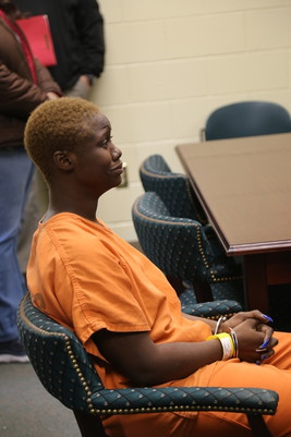 Mia Thornton begins to cry during a first appearance hearing at Sumter-Lee Regional Detention Center on Thursday.
