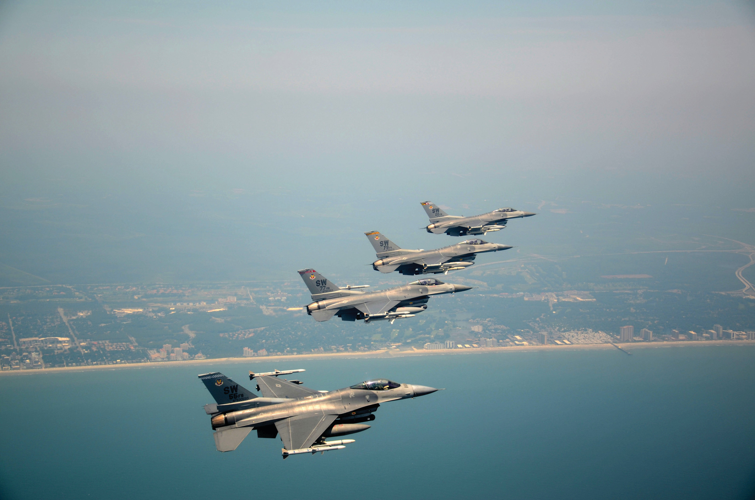 Four F-16 Vipers assigned to the 20th Fighter Wing, Shaw Air Force Base, fly over the South Carolina coast as part of a past Salute from the Shore tribute.