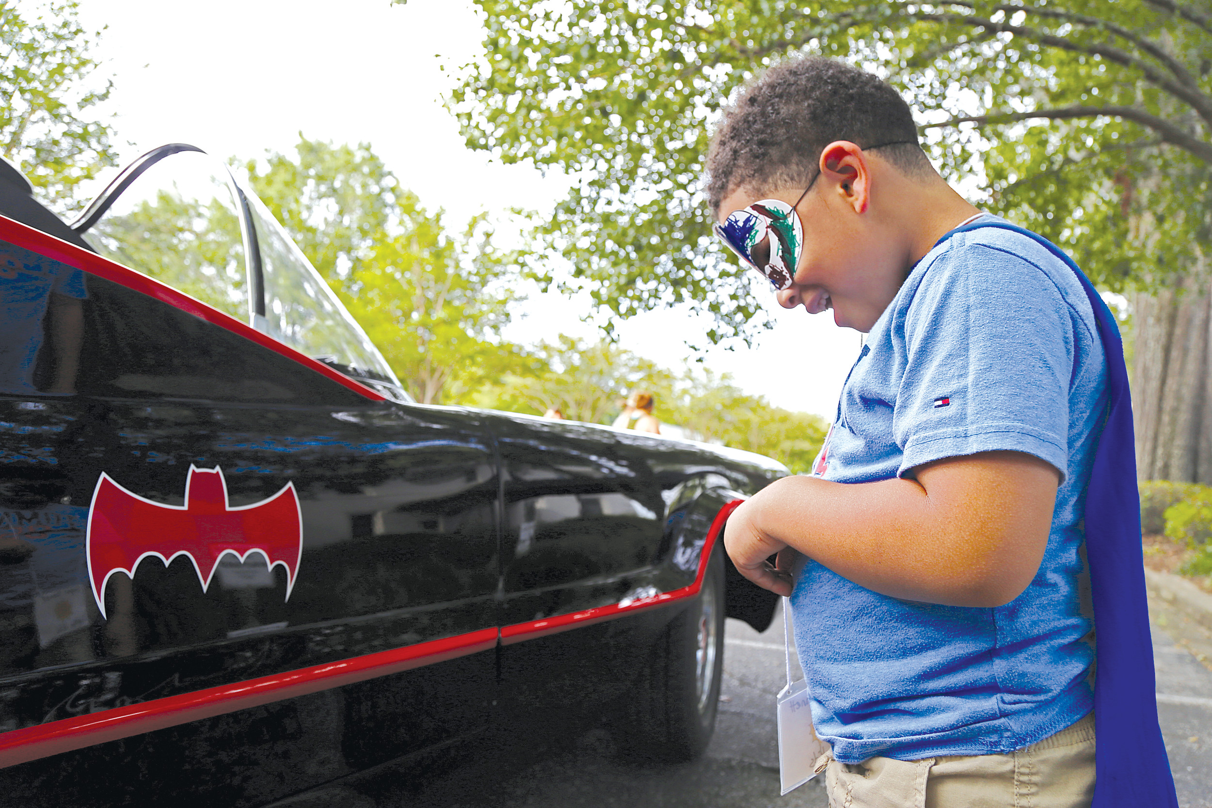 "A child at First Presbyterian Church's ""Hero Central"" Vacation Bible School gasps as he checks out Lane Latham's hand-built Batmobile."
