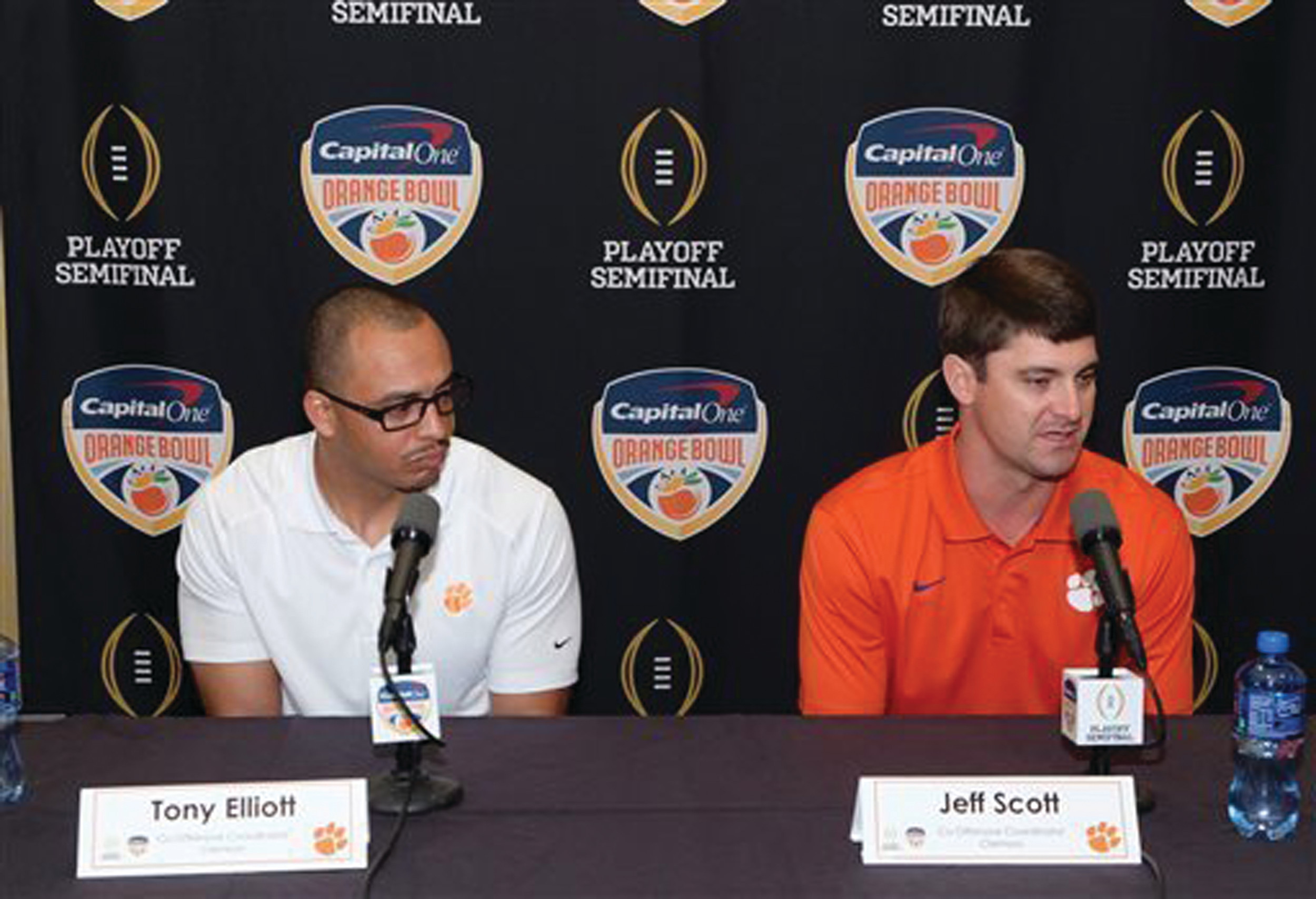Clemson co-offensive coordinators Tony Elliott, left, and Jeff Scott speak to the media at a news conference in Fort Lauderdale, Fla., in 2015 Elliott and make $800,000 apiece, meaning that more than half of the Tigers' $5.7 million salary for its nine football assistants goes to its position leaders.