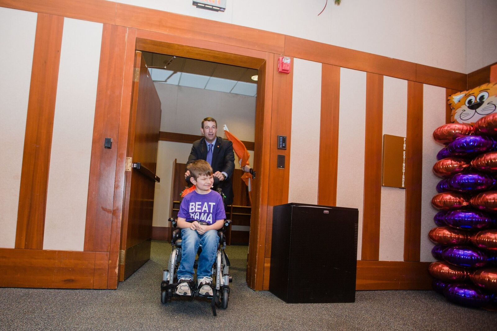 Clemson head coach Dabo Swinney brings a patient into the part on Saturday.