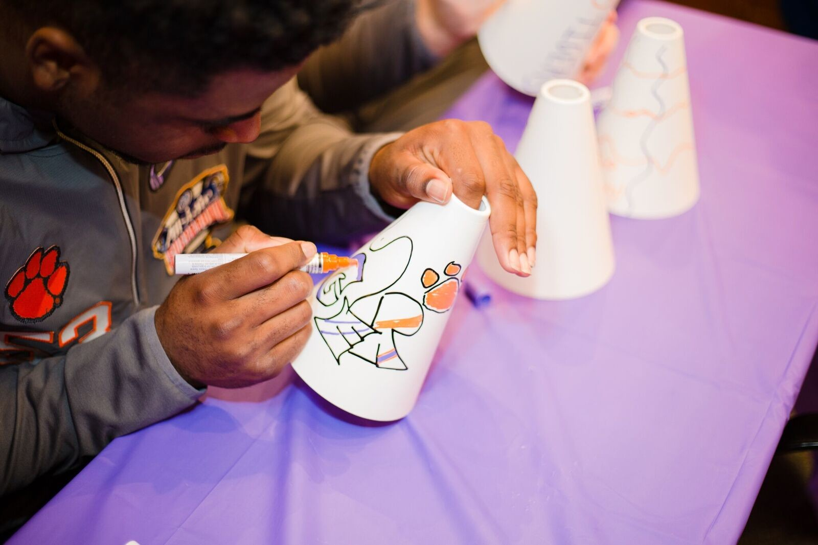 A Clemson player gets in on the activities with patients at the children's hospital Saturday.