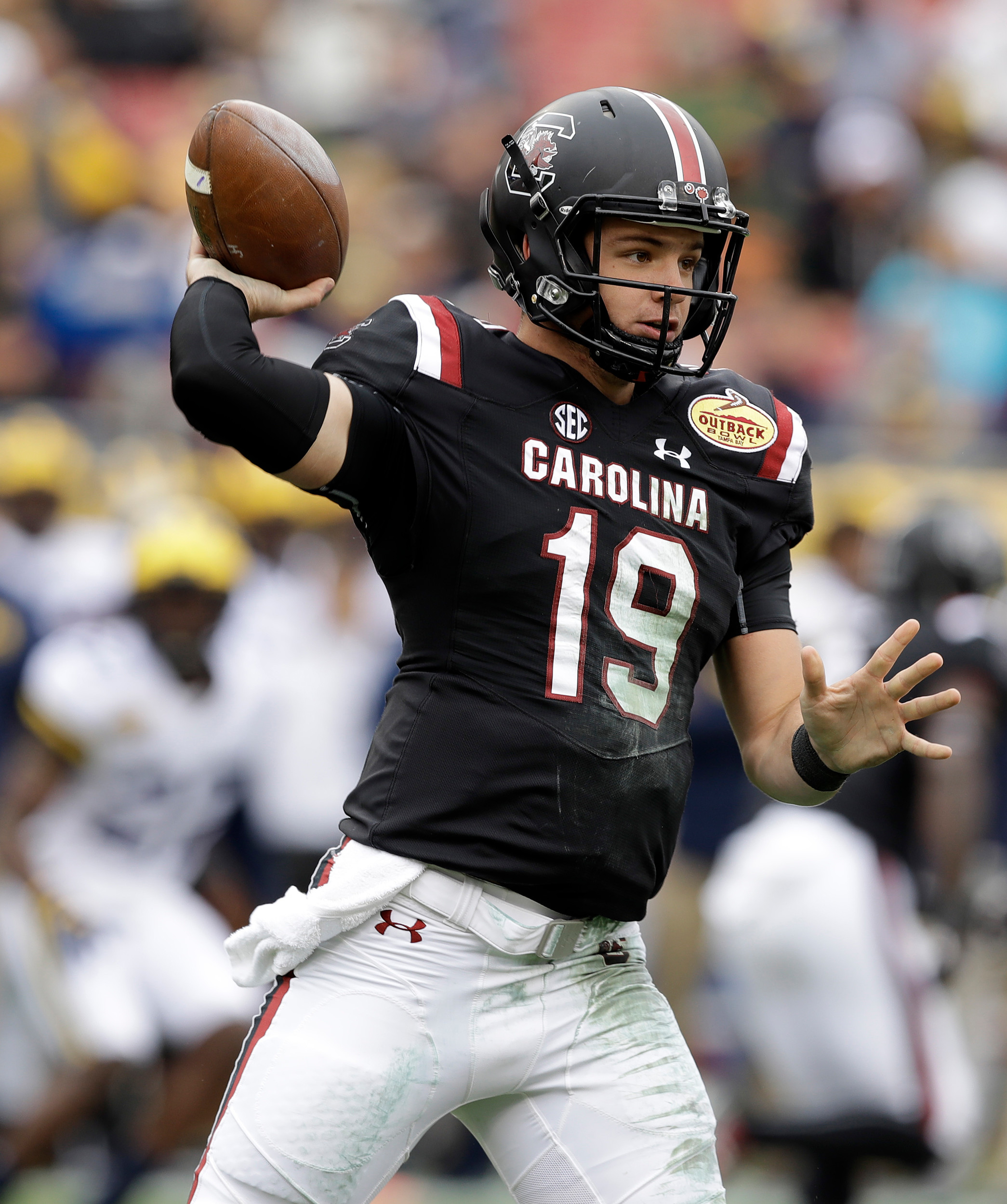 THE ASSOCIATED PRESSSouth Carolina quarterback Jake Bentley throws a pass during the Gamecocks' 26-19 victory over Michi gan in the Outback Bowl on Monday in Tampa, Fla. USC rallied from a 19-3, third-quarter deficit to pick up the victory.