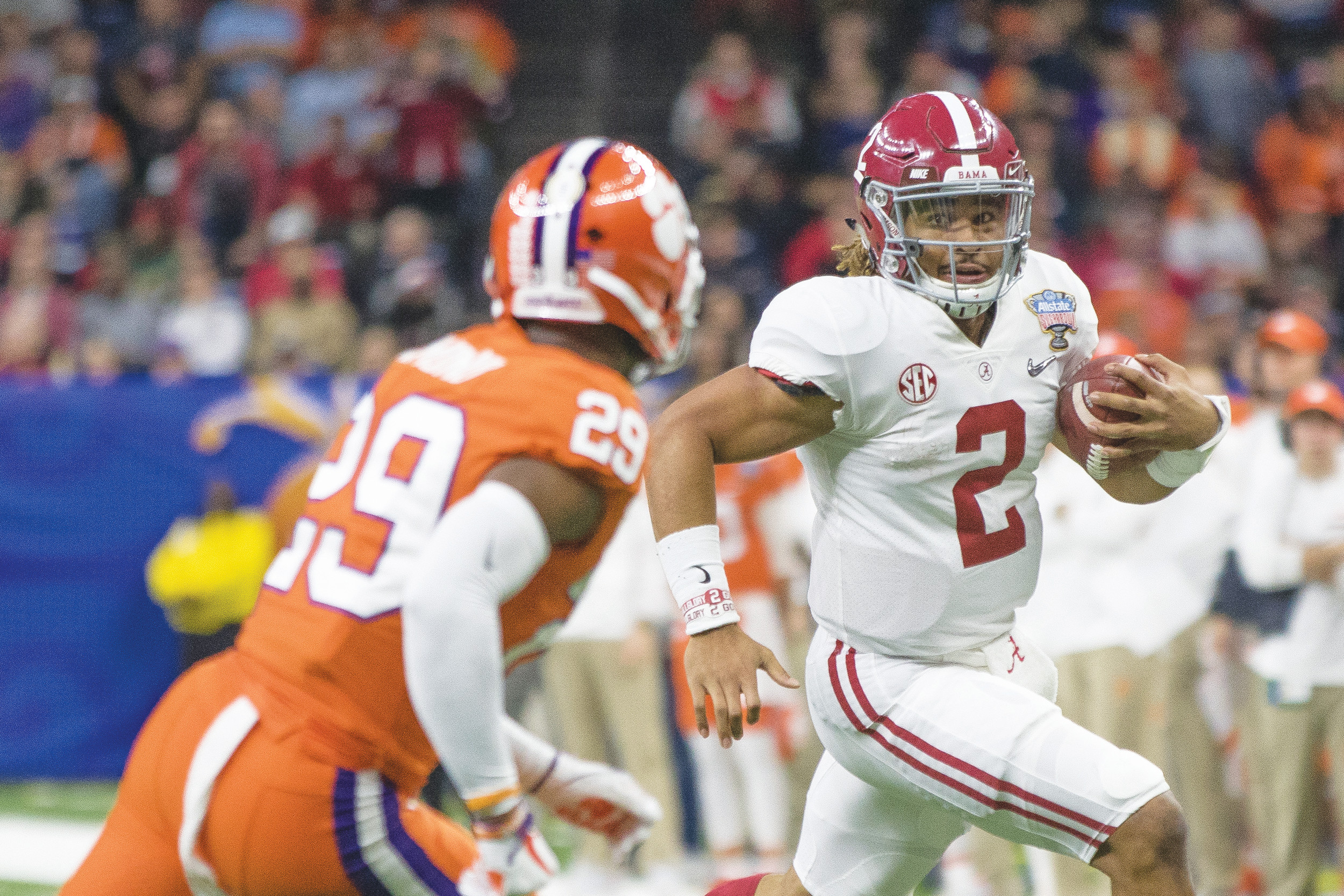 Alabama quarterback Jalen Hurts (2) looks for running room against Clemson quarterback Marcus Edmond in the Crimson Tide's 24-6 victory in the Sugar Bowl on Monday in New Orleans. Alabama will play for Georgia for the national title in Atlanta next week.