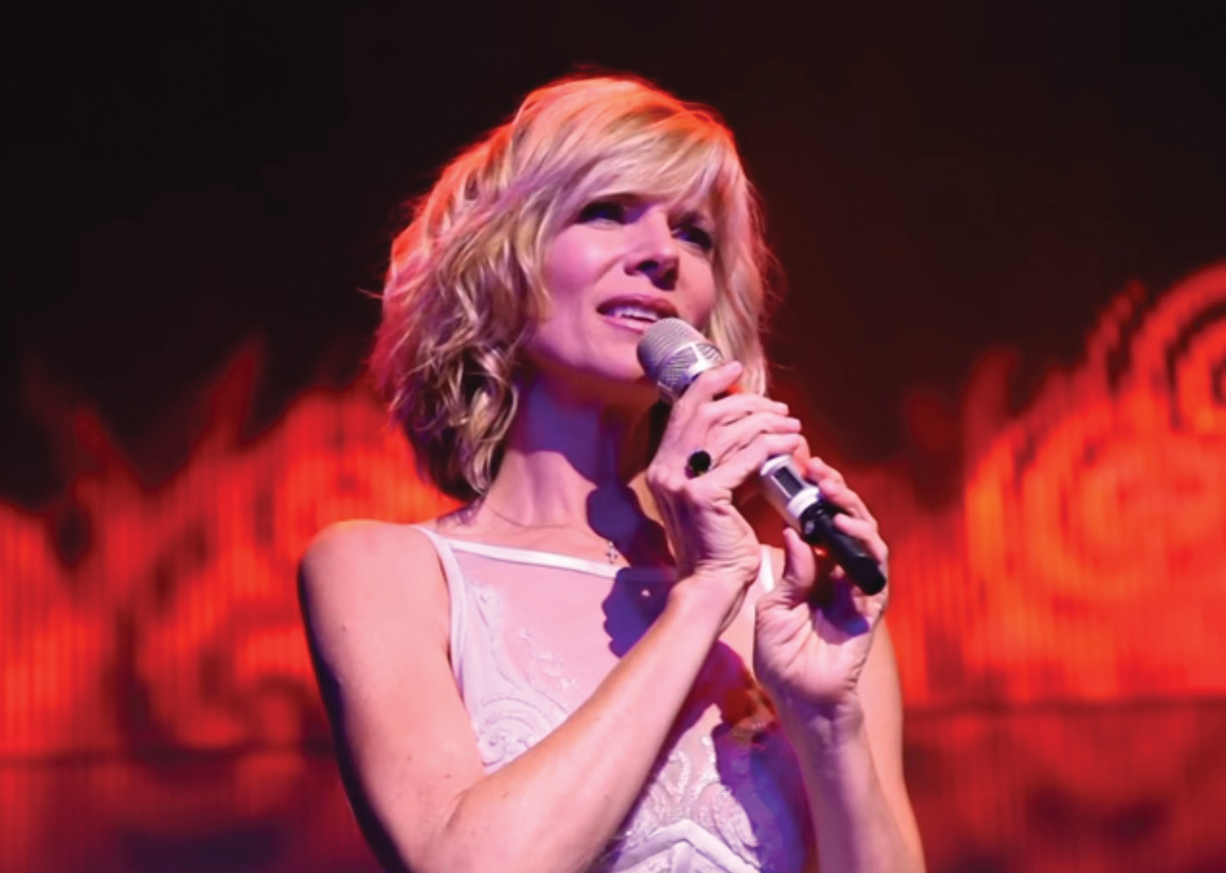 Debby Boone is shown at a recent concert. She plans to tour and record CDs, a format not available 40 years ago.