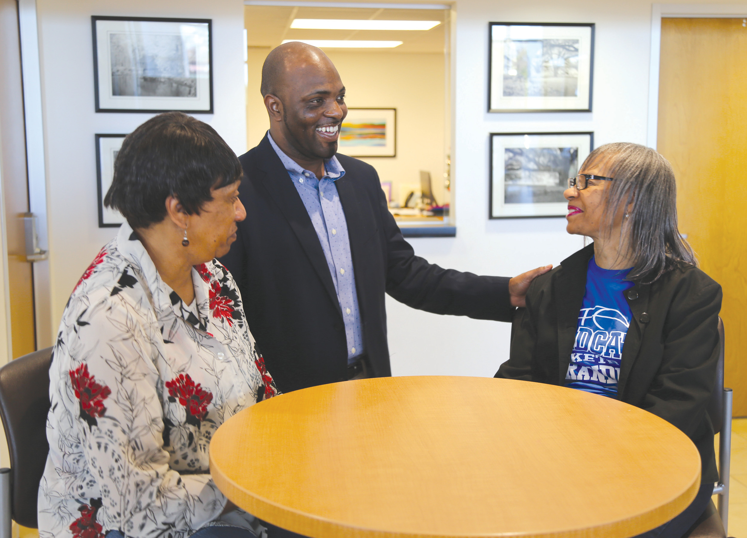 Greg Jenkins, center, shares a light moment with personal friends and customers Julia Holley, right, and Genesis Burbridge recently at Scott Will Toyota at 2540 Broad St.