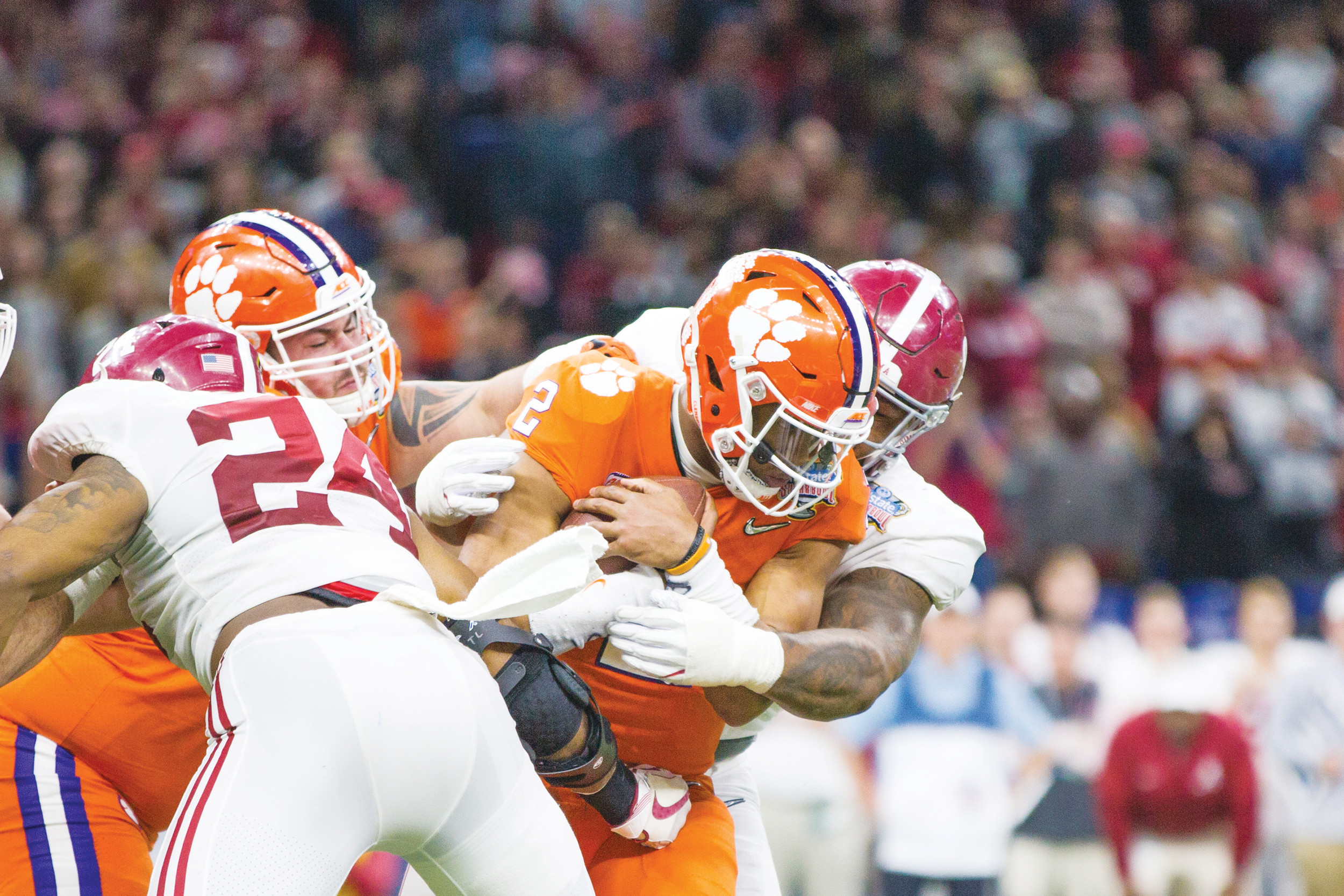 An Alabama defender wraps up Clemson quarterback Kelly Bryant during the Tigers' 24-6 loss to the Crimson Tide on Monday in the