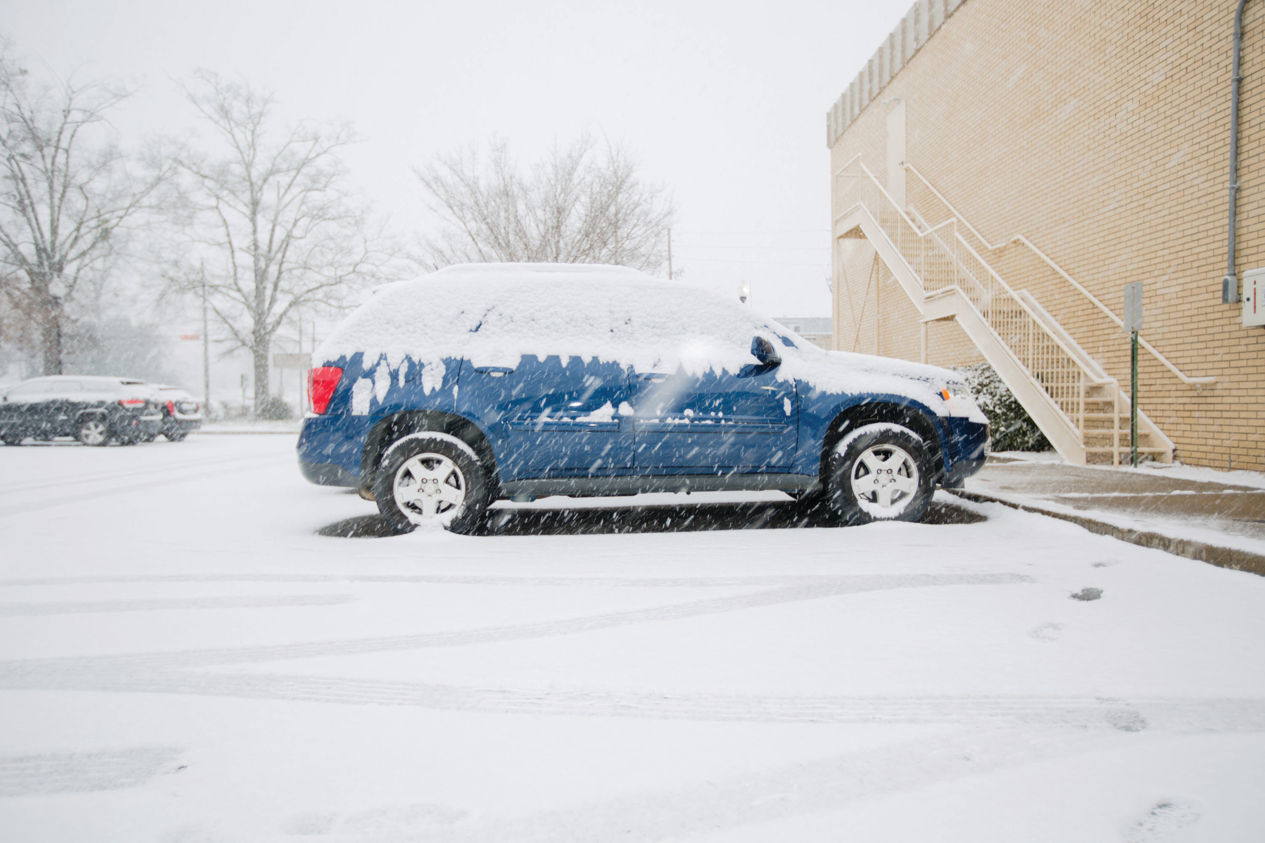 The Sumter Item's parking lot is seen during the snowfall.