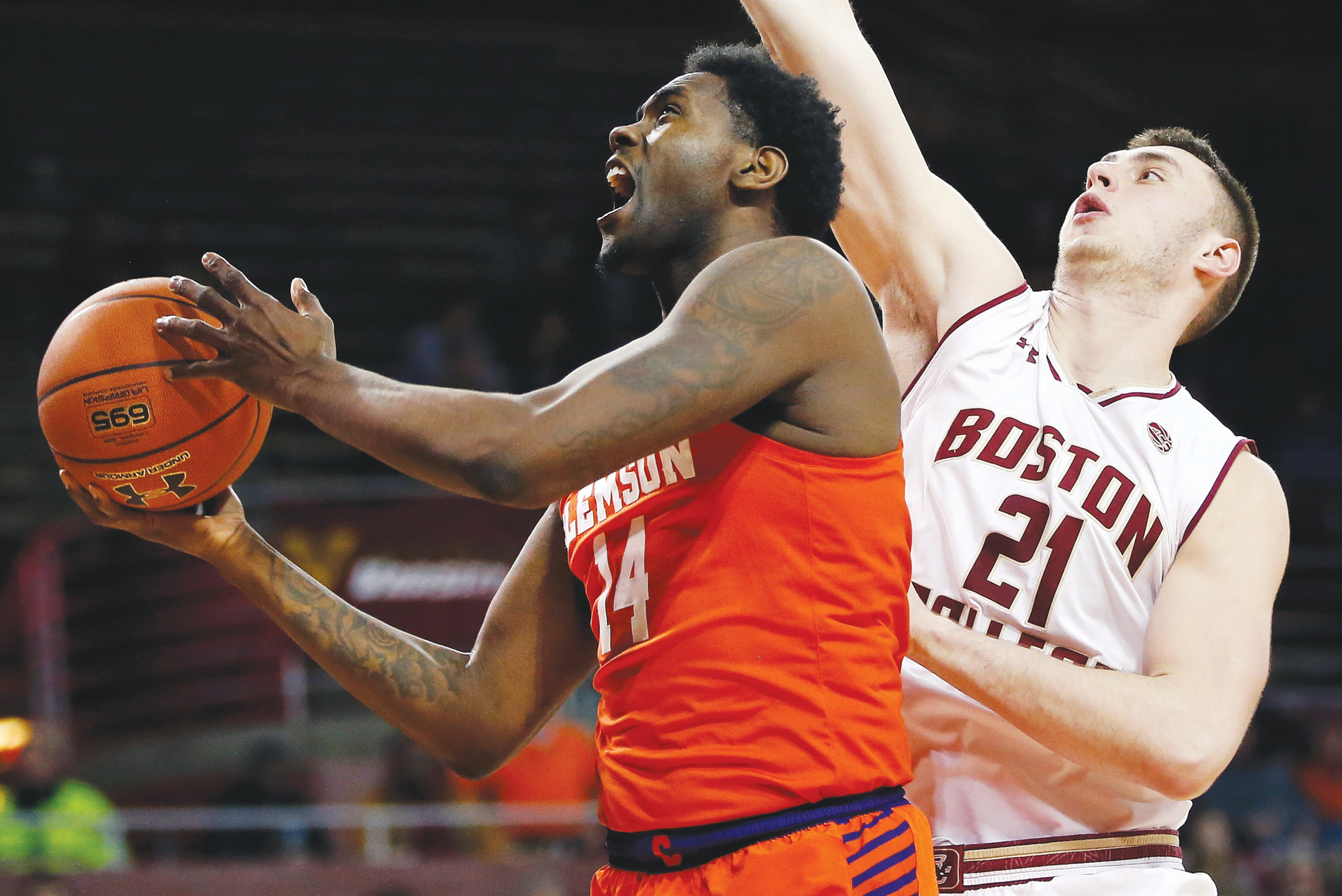 Clemson's Elijah Thomas (14) shoots in front of Boston College's Nik Popovic (21) during the Tigers' 74-70 win on Wednesday in Boston.