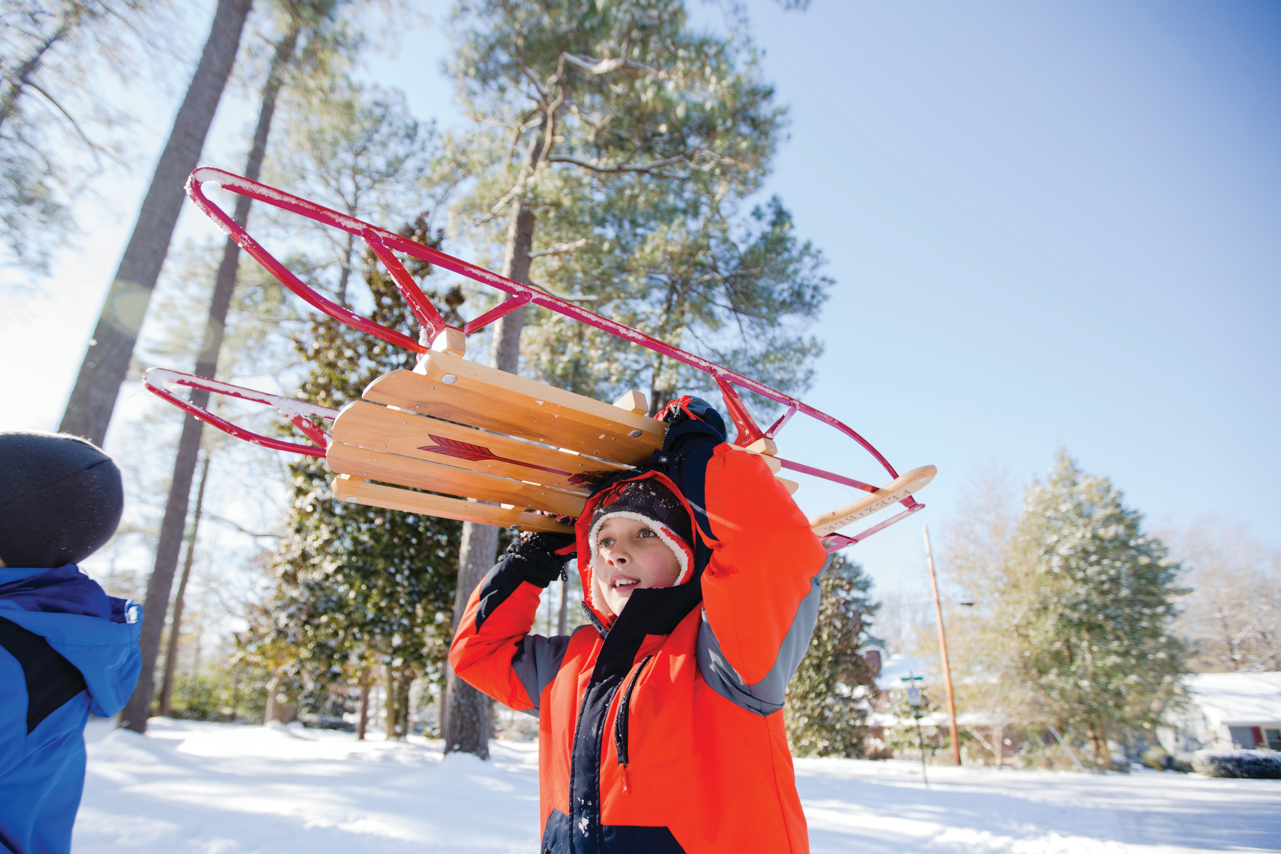 Banks Smith, 9, hauls a sled down an icy street on Thursday morning in Sumter.