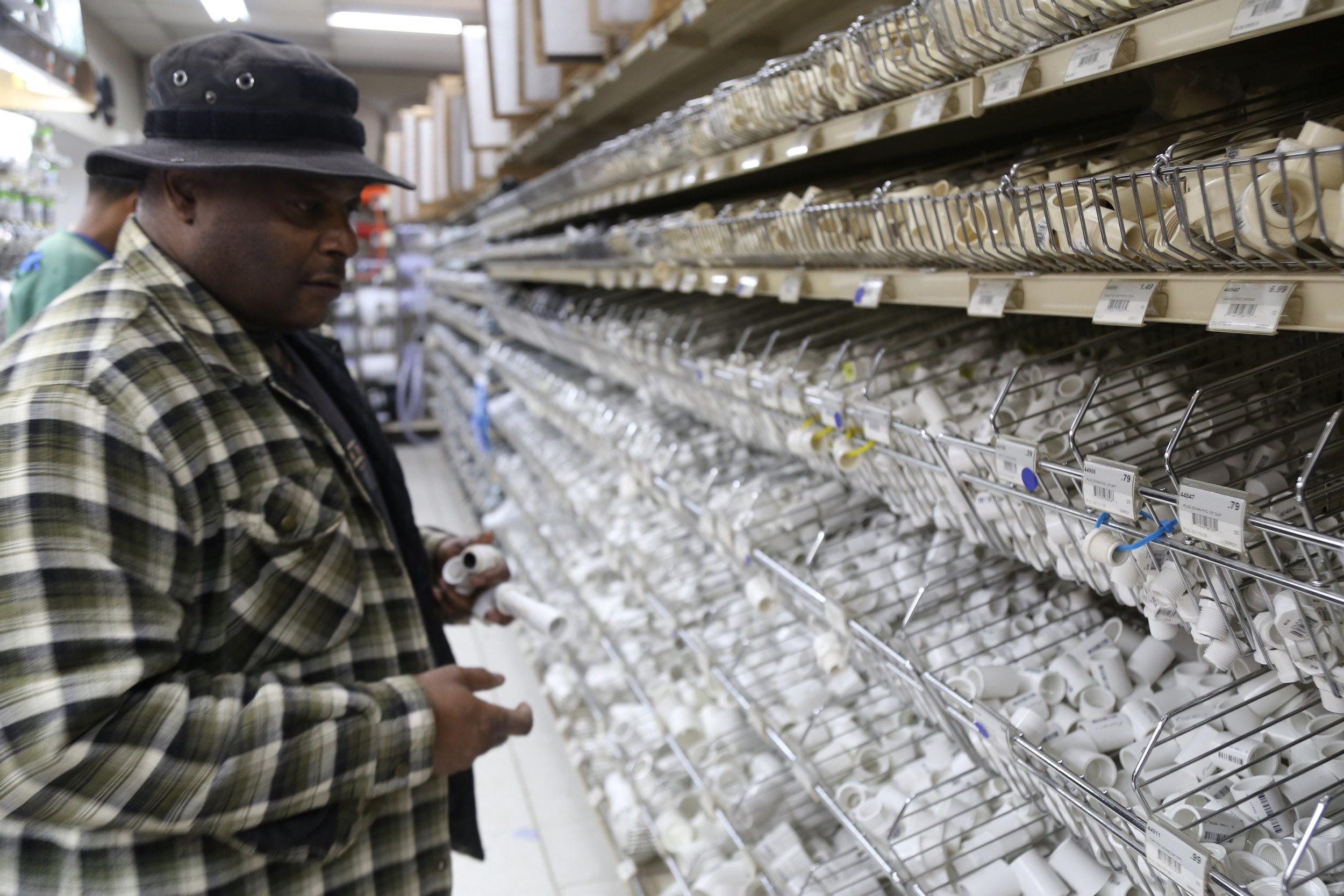 After his pipes burst at home Wednesday night, Sumter resident Freddie Mobley looks at pipe fittings Thursday at Simpson Ace Hardware, 32 W. Liberty St.