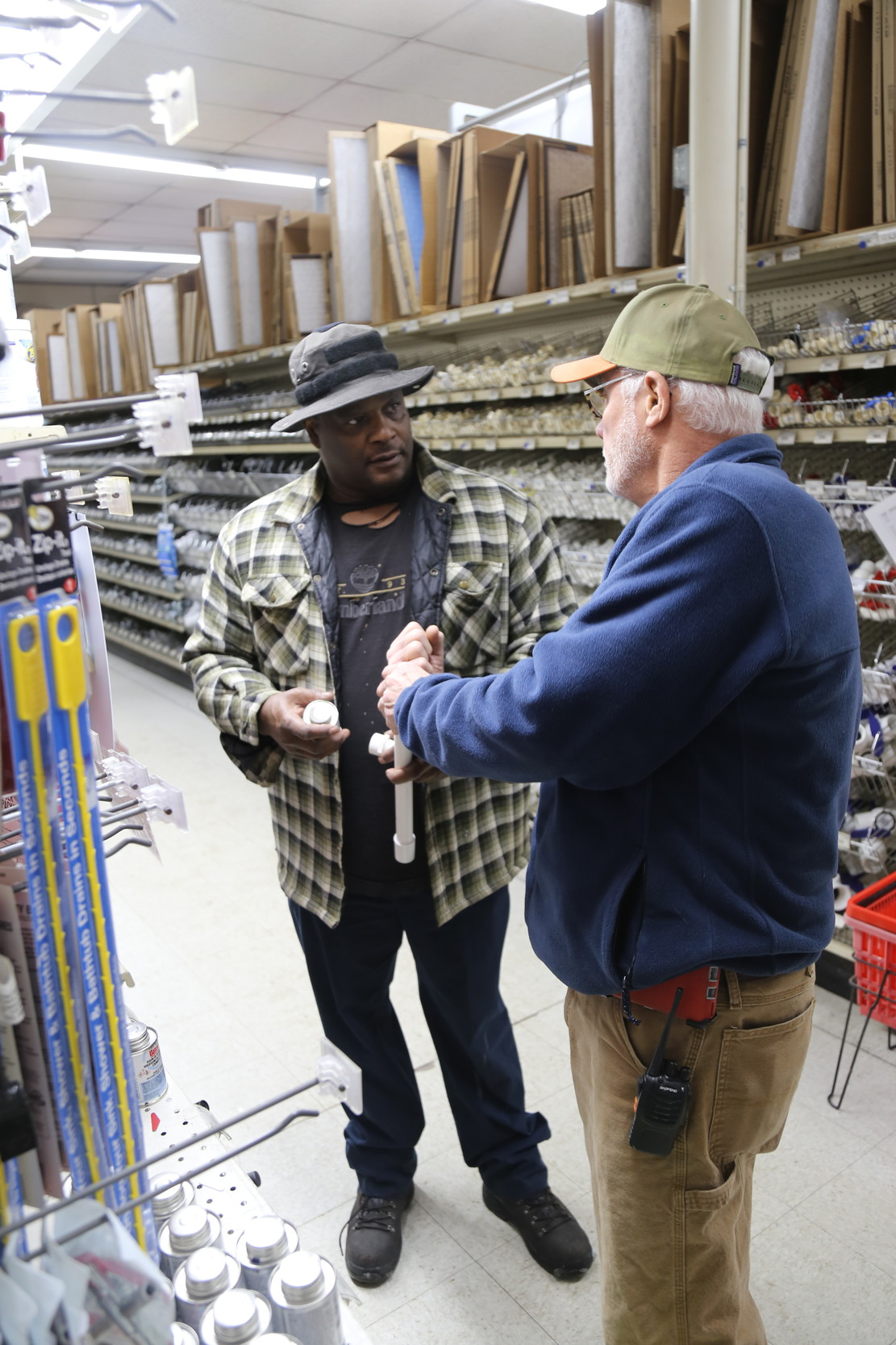 Sumter resident Freddie Mobley, left, listens Thursday as Simpson Hardware's Mike Brown explains which pipes would be best to purchase at the store, 32 W. Liberty St.