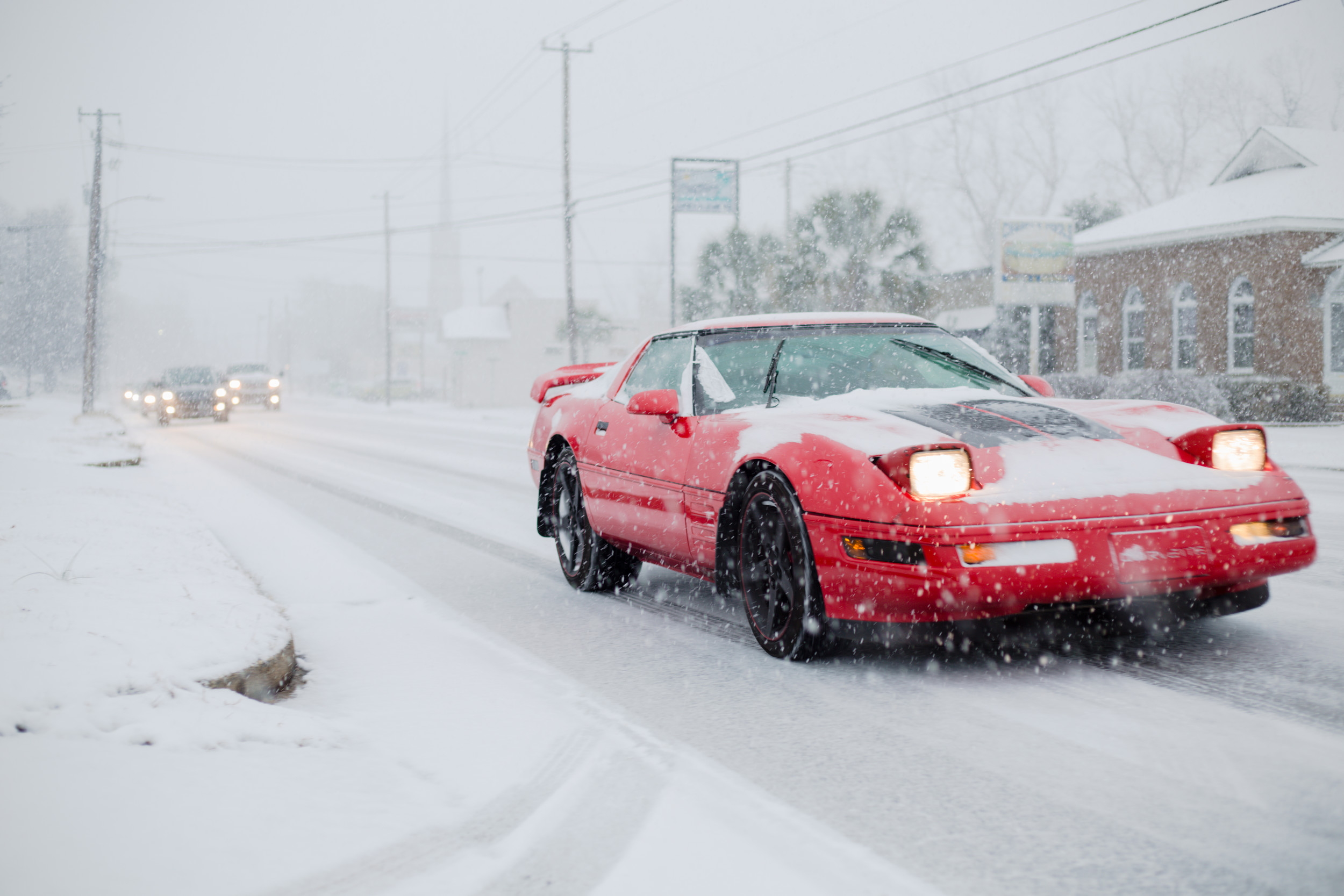Vehicle navigate West Liberty Street in the snow Wednesday.