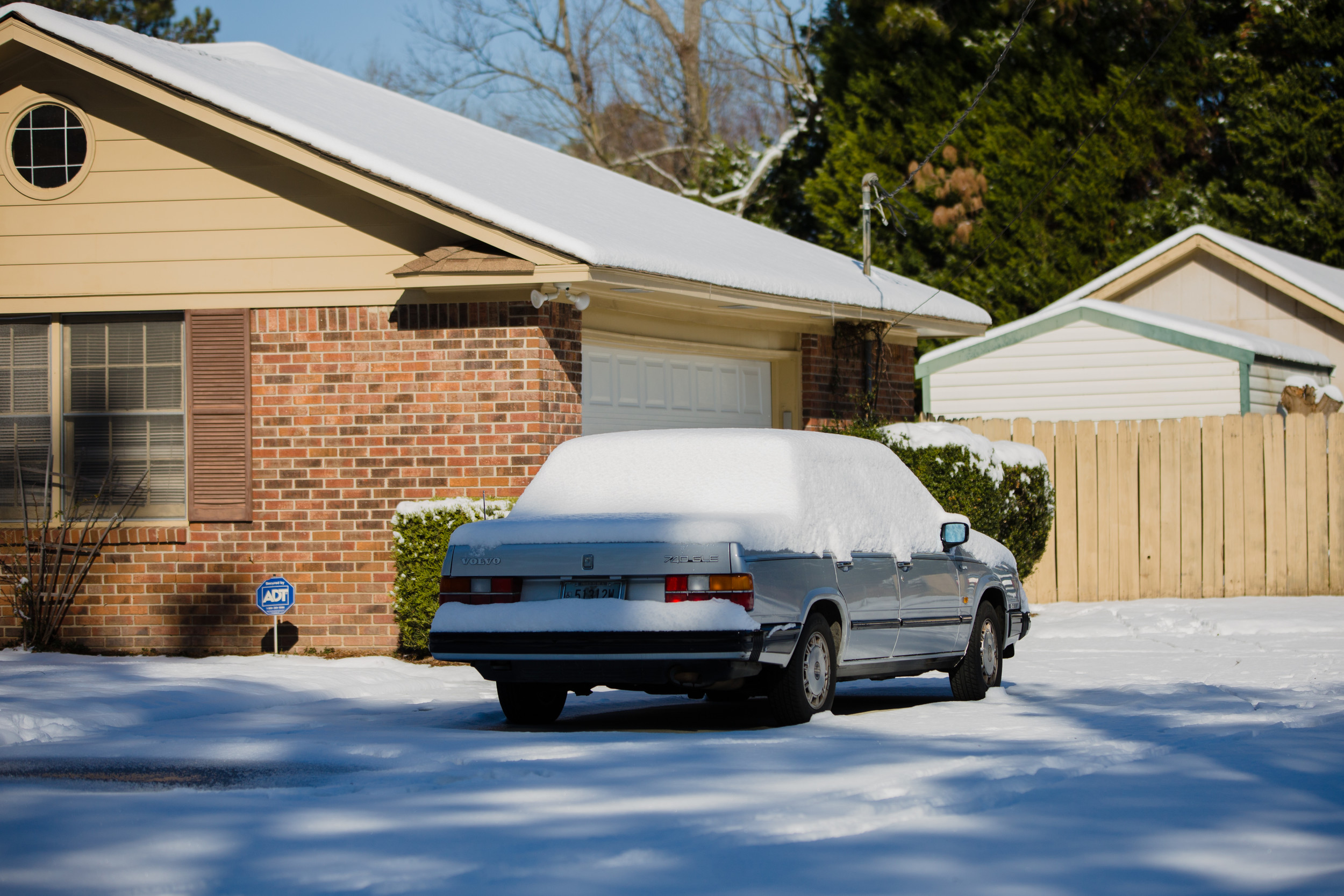 A car is snowed in on Thursday morning in Sumter.