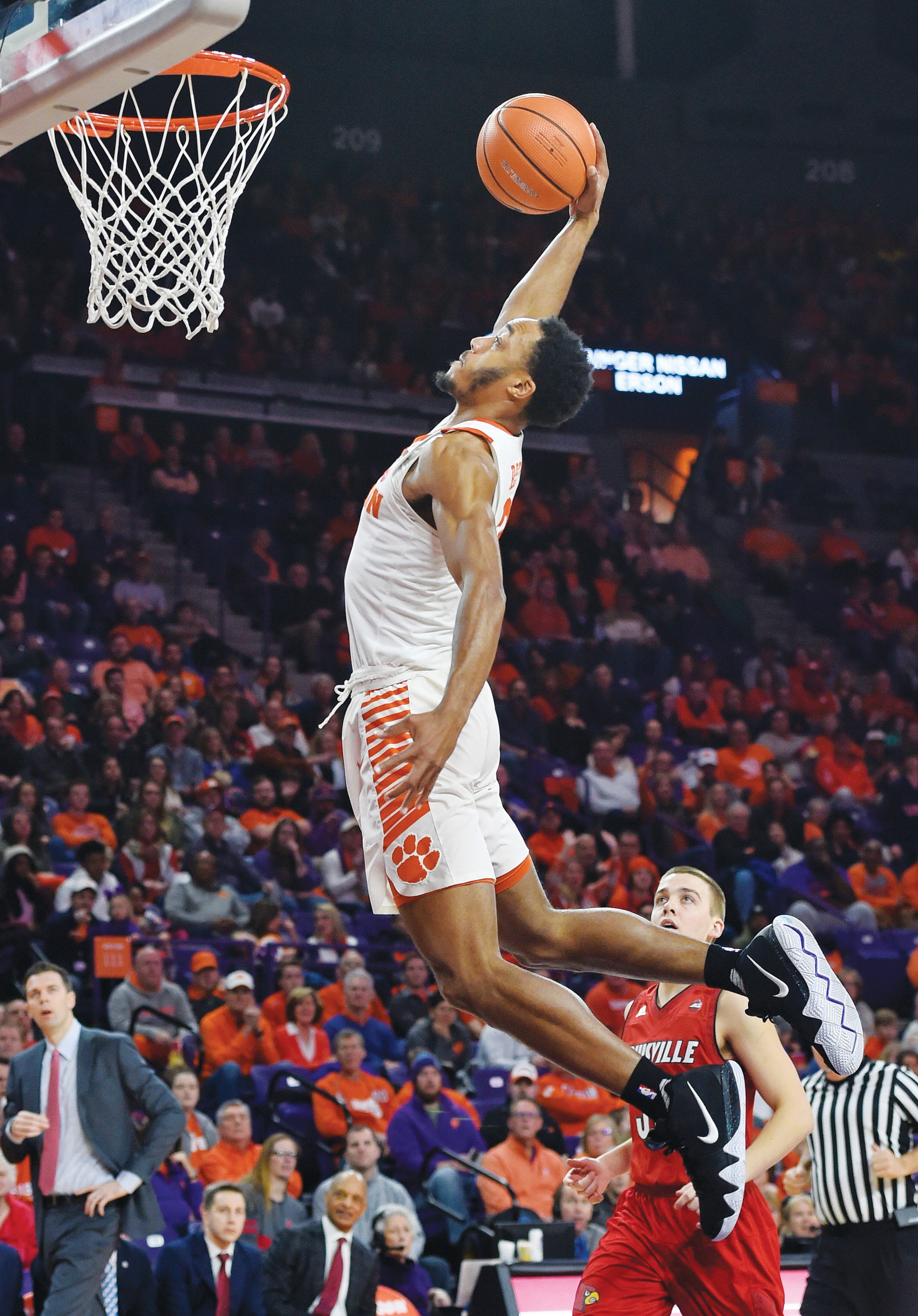 Clemson's Marcquise Reed goes up for a dunk during the first half of the Tigers' 74-69 overtime victory over Louisville on Saturday in Clemson.