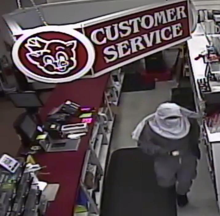 A suspect is seen on video surveillance footage in the South Sumter Piggly Wiggly early Sunday morning.