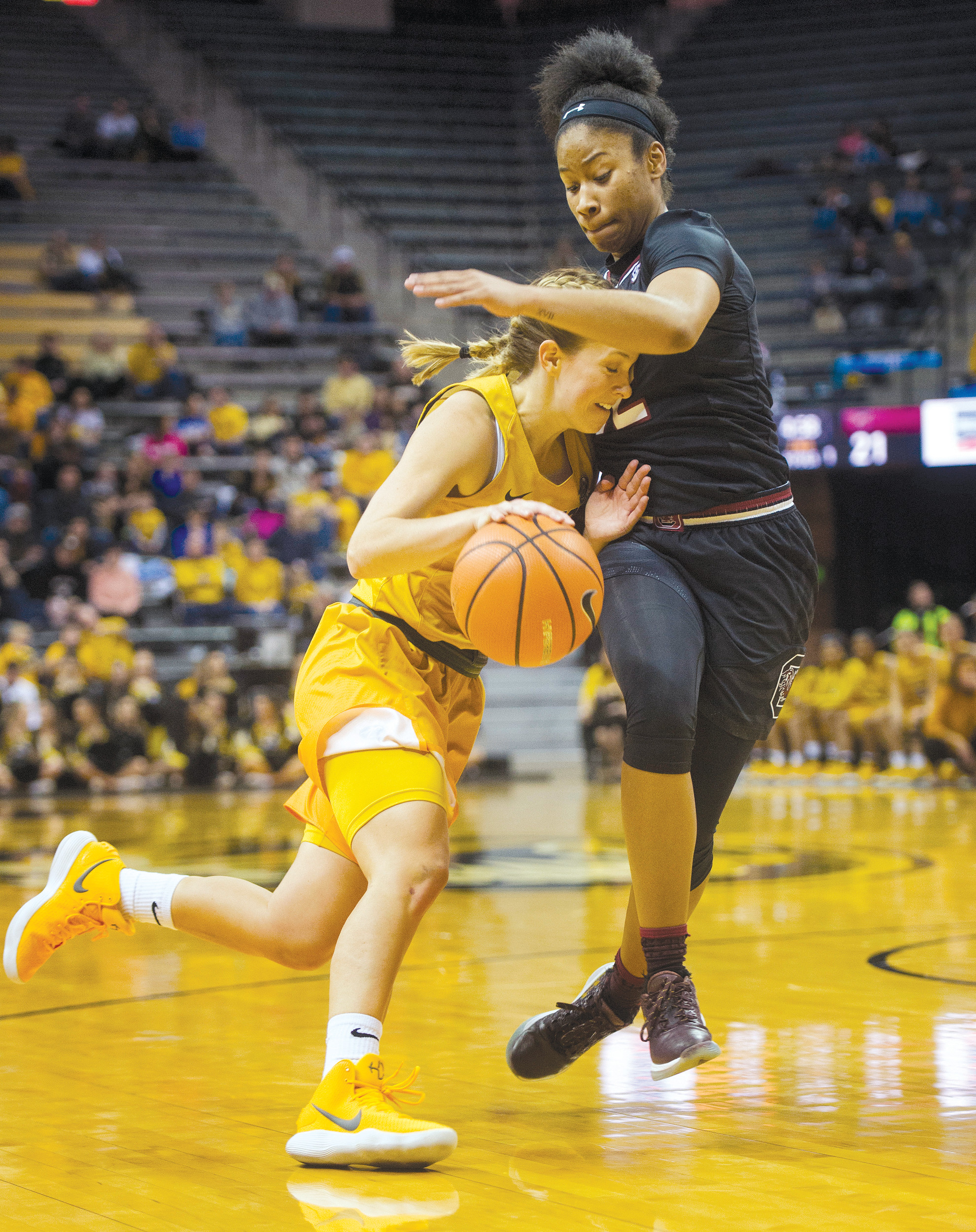 Missouri's Lauren Aldridge, left, is fouled by South Carolina's Tyasha Harris during the first half of an NCAA college basketball game Sunday in Columbia, Missouri.