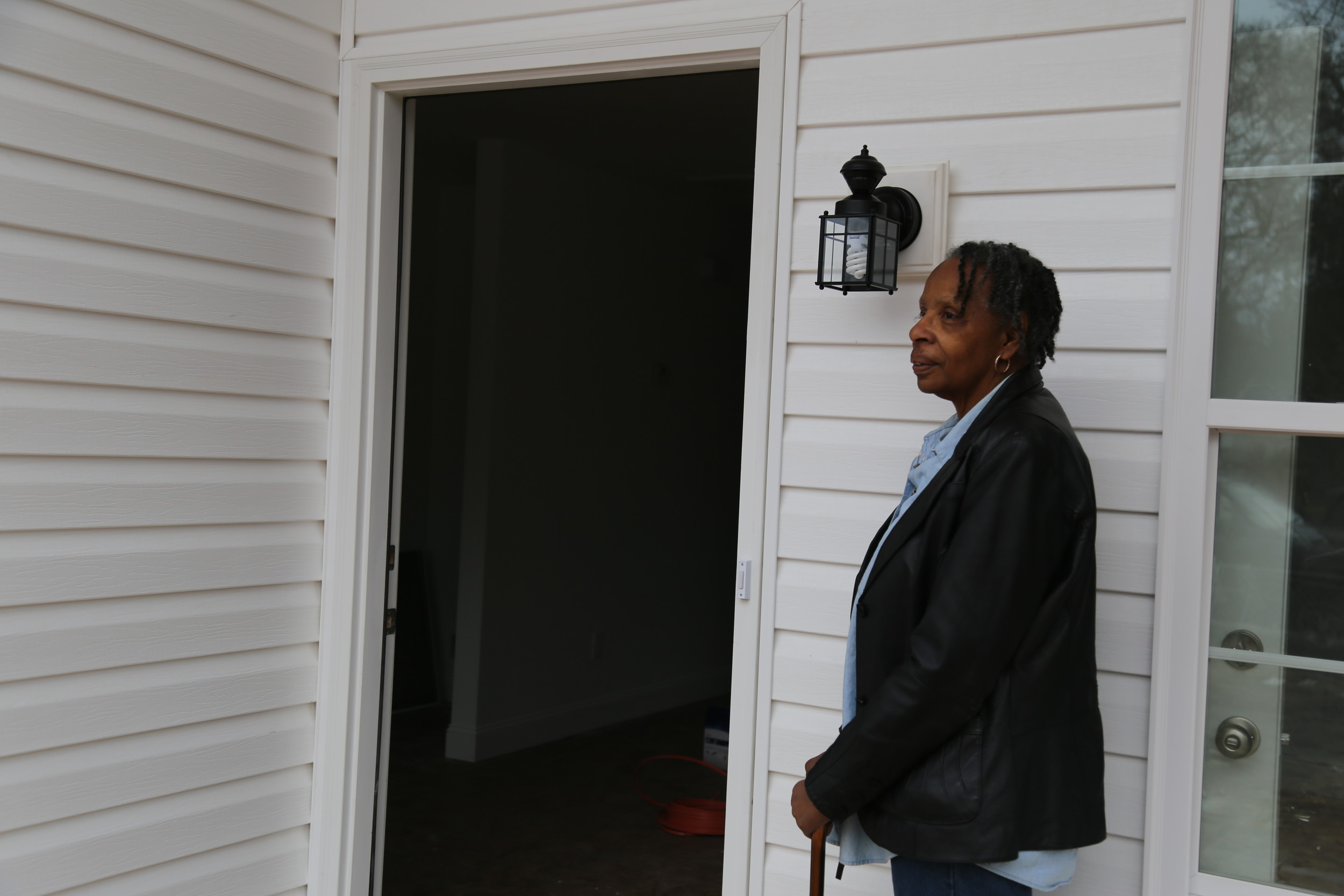 BRUCE MILLS / THE SUMTER ITEMBarbara Harris stands outside the front door of her soon-to-be-completed new home on Charles Street on Wednesday.