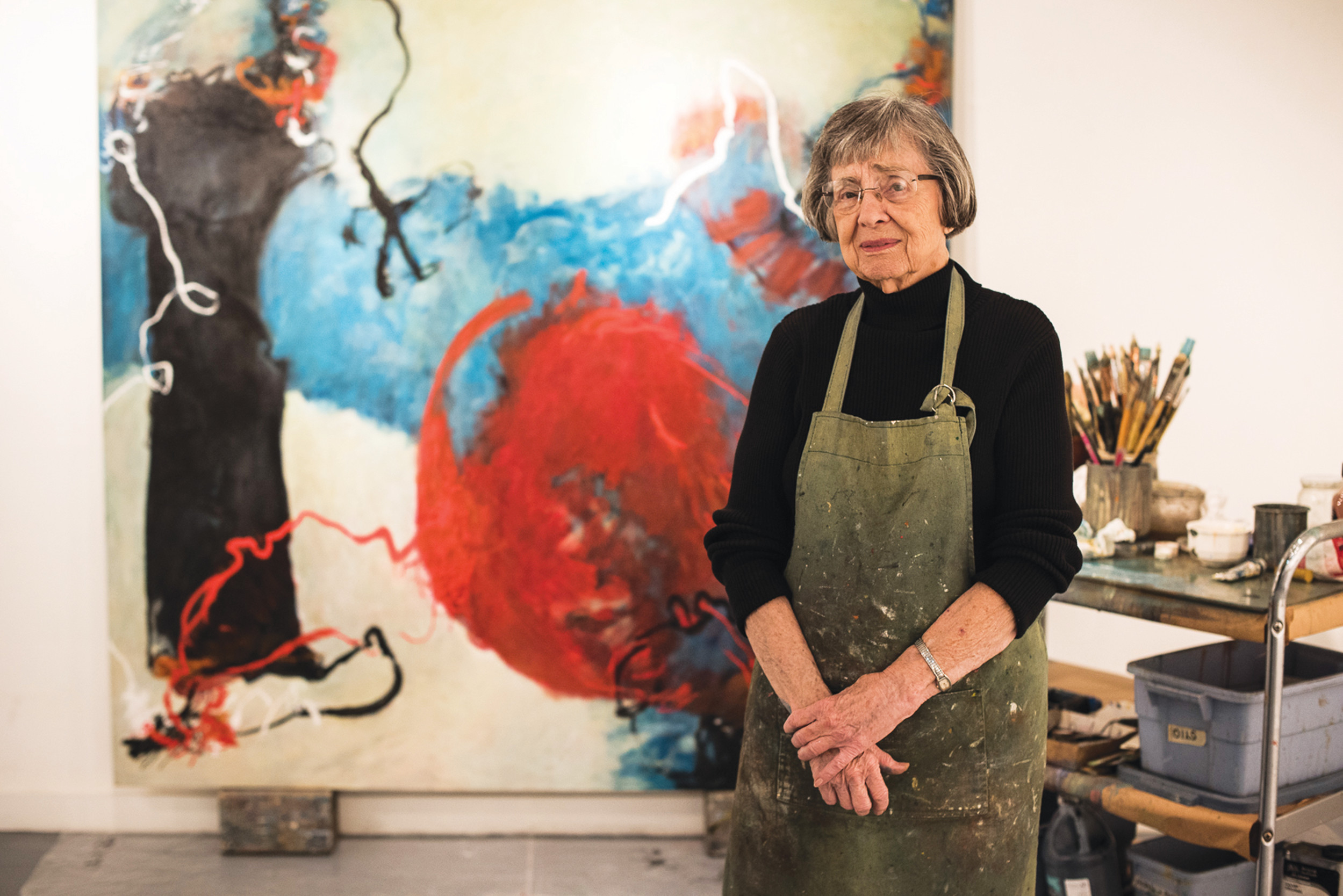 Laura Spong, abstract expressionist painter, is shown in her Columbia studio. An exhibition of her work will open Thursday at the Sumter County Gallery of Art.