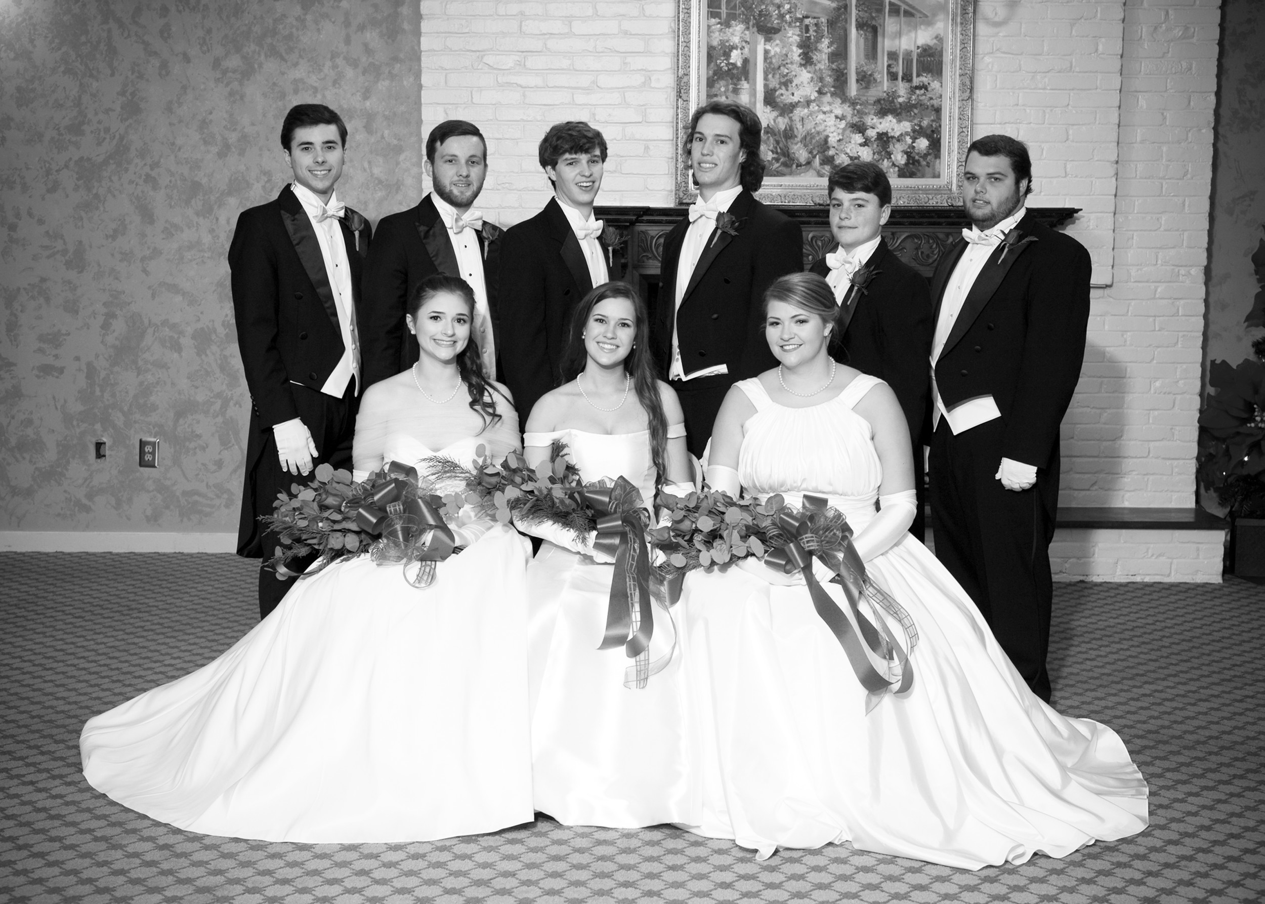 From left: front row, debutantes Callie Elizabeth Graham, Caroline Elizabeth Land and Olivia Dean Wilson; and back row, escorts John William Graham, Tyler Logan Sprott, William Anders Land, James Ceth Land, John Joe Wilson III and Raymond Bradley Davis. One son was presented, James Ceth Land.