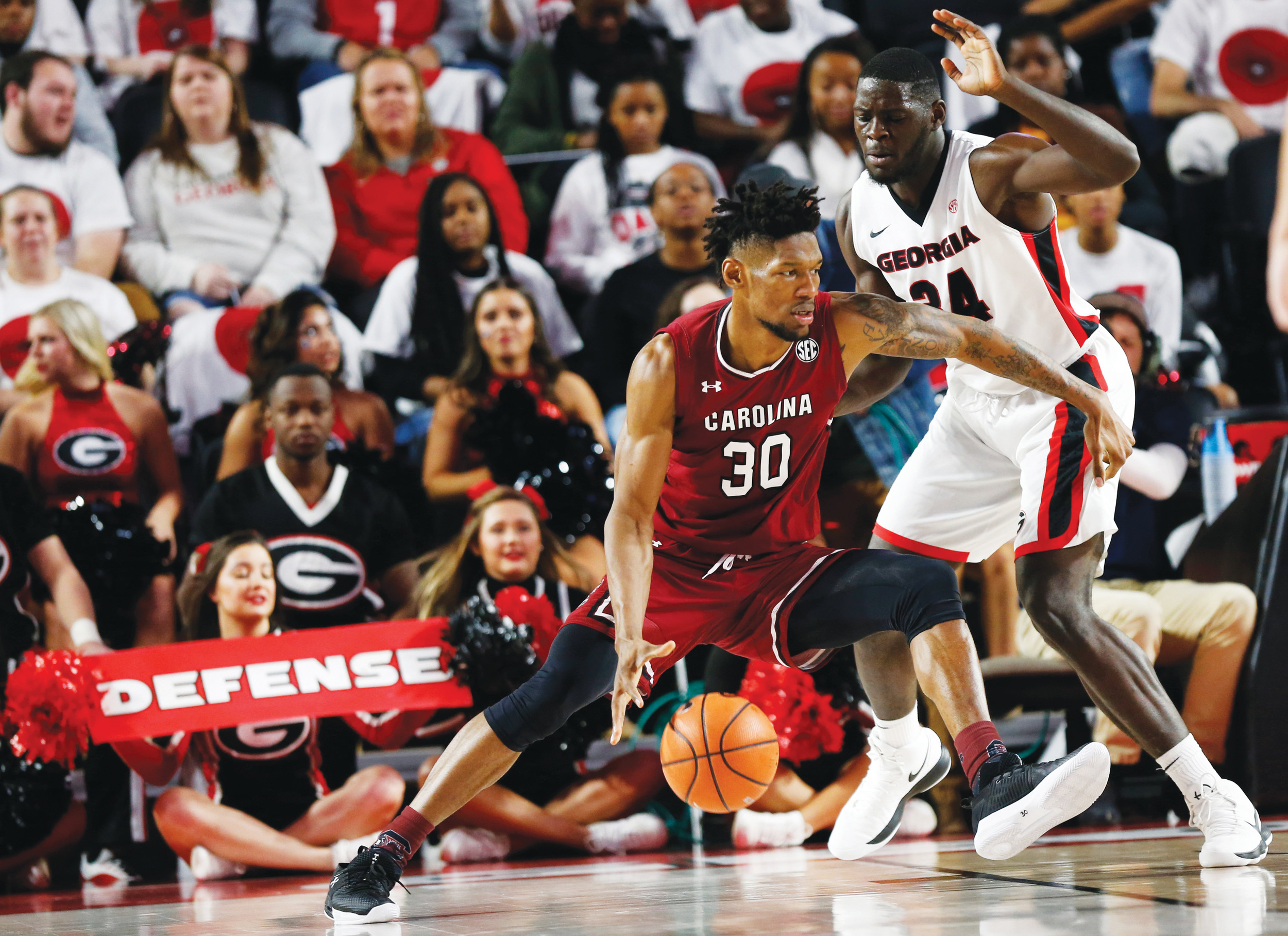South Carolina forward Chris Silva (30) drives against Georgia forward Derek Ogbeide (34) in the first half of the Gamecocks' victory over the Bulldogs on Friday in Athens, Georgia.