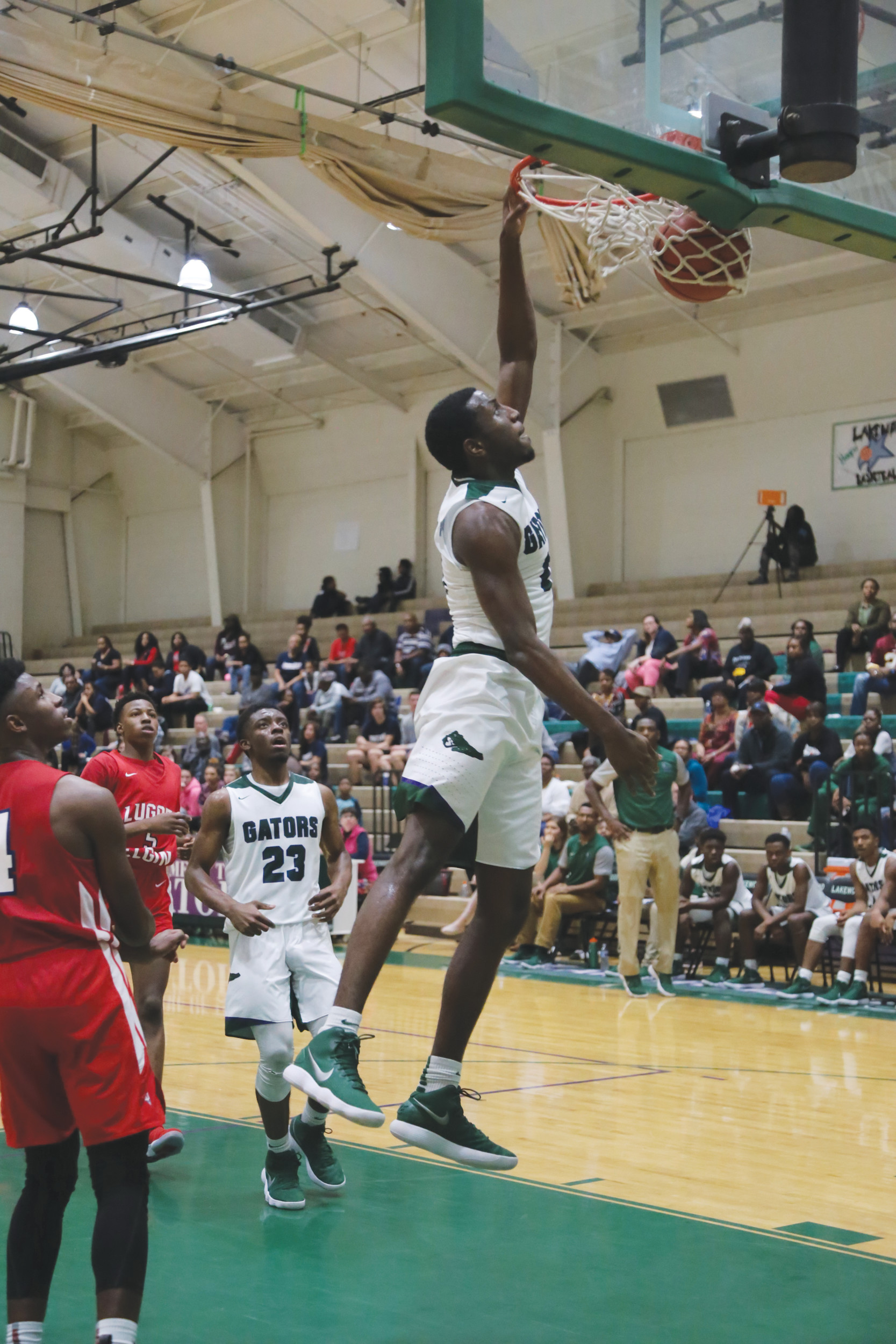 Lakewood's Akeem Lawson throws down a dunk during the third quarter of the Gators' 66-49 Region VI-4A victory over Lugoff-Elgin on Friday at The Swamp. Lawson finished with a double-double of 24 points and 12 rebounds.