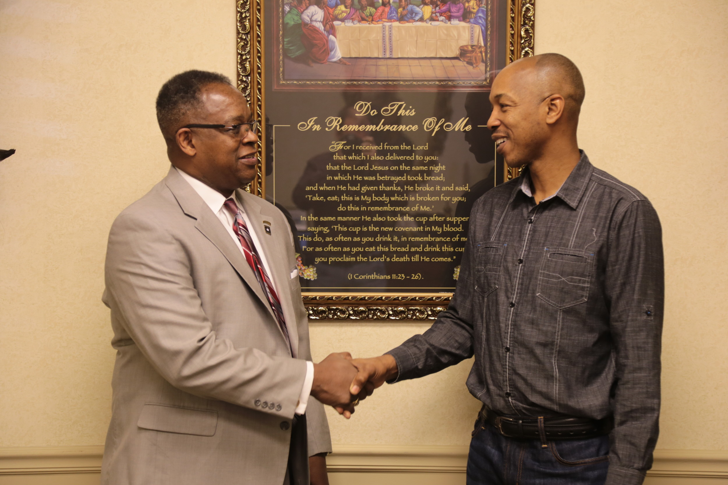 "Sumter City Councilman and ""Dream Team"" member Calvin Hastie, left, shakes hands with Garfield Williams on Friday at Hastie Law Firm, 7 E. Hampton Ave."