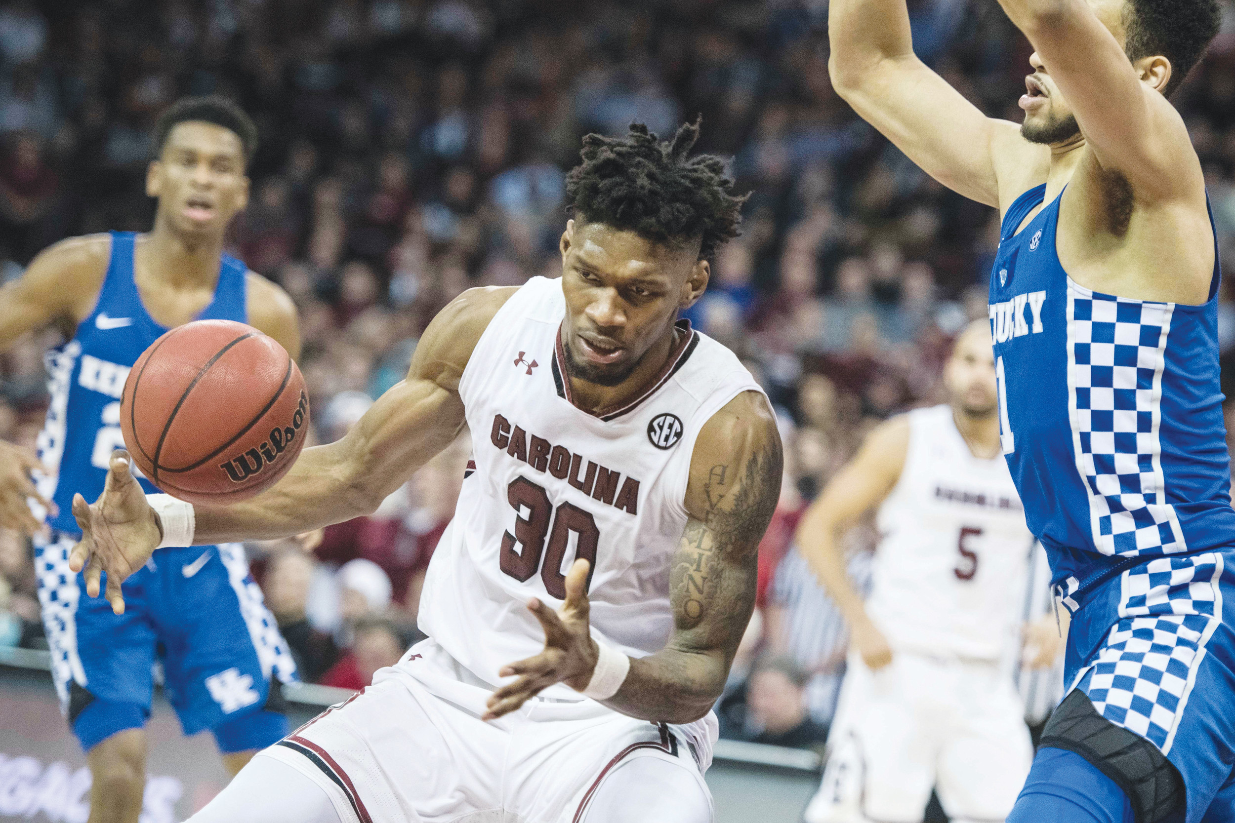 South Carolina forward Chris Silva (30) reaches for a pass against Kentucky forward Sacha Killeya-Jones (1) during the second half of the Gamecocks' 76-68 victory over the 18th-ranked Wildcats on Tuesday in Columbia.