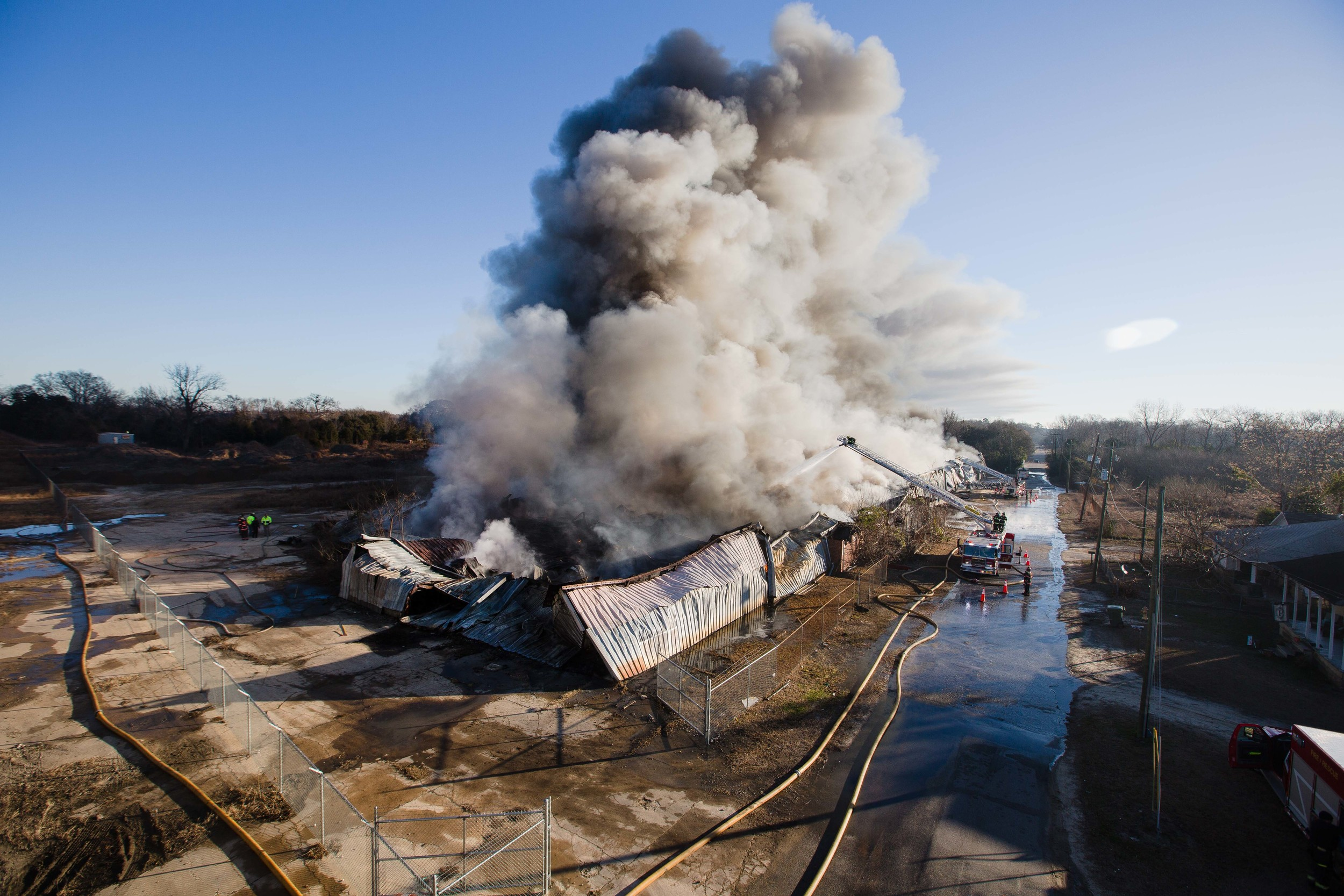 A massive fire burned what officials said was a 400,000-square-foot warehouse on Hauser Street early Friday morning into daylight hours.