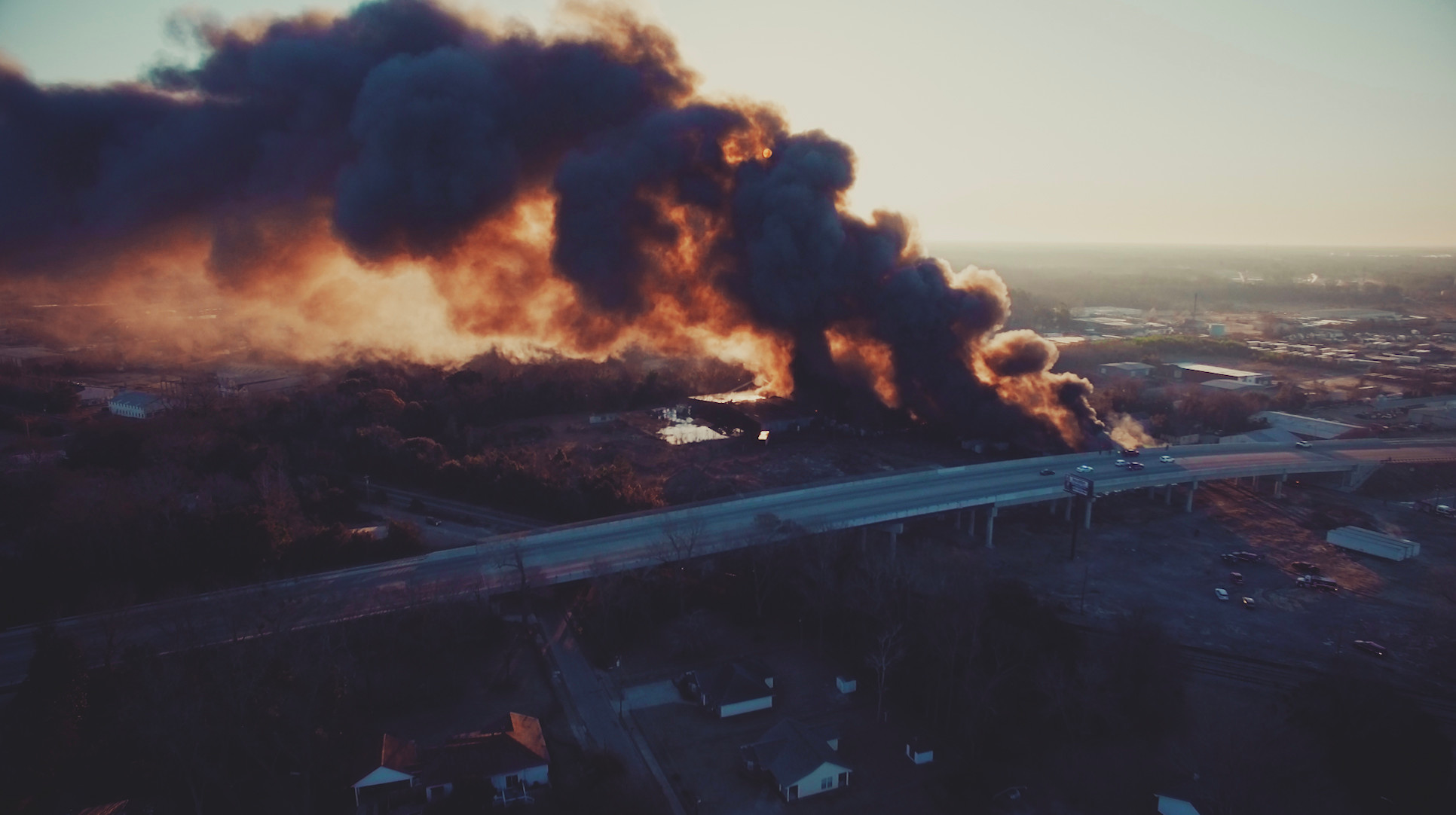 A drone image captures the smoke plume caused by a 400,000-square-foot warehouse fire Friday morning.