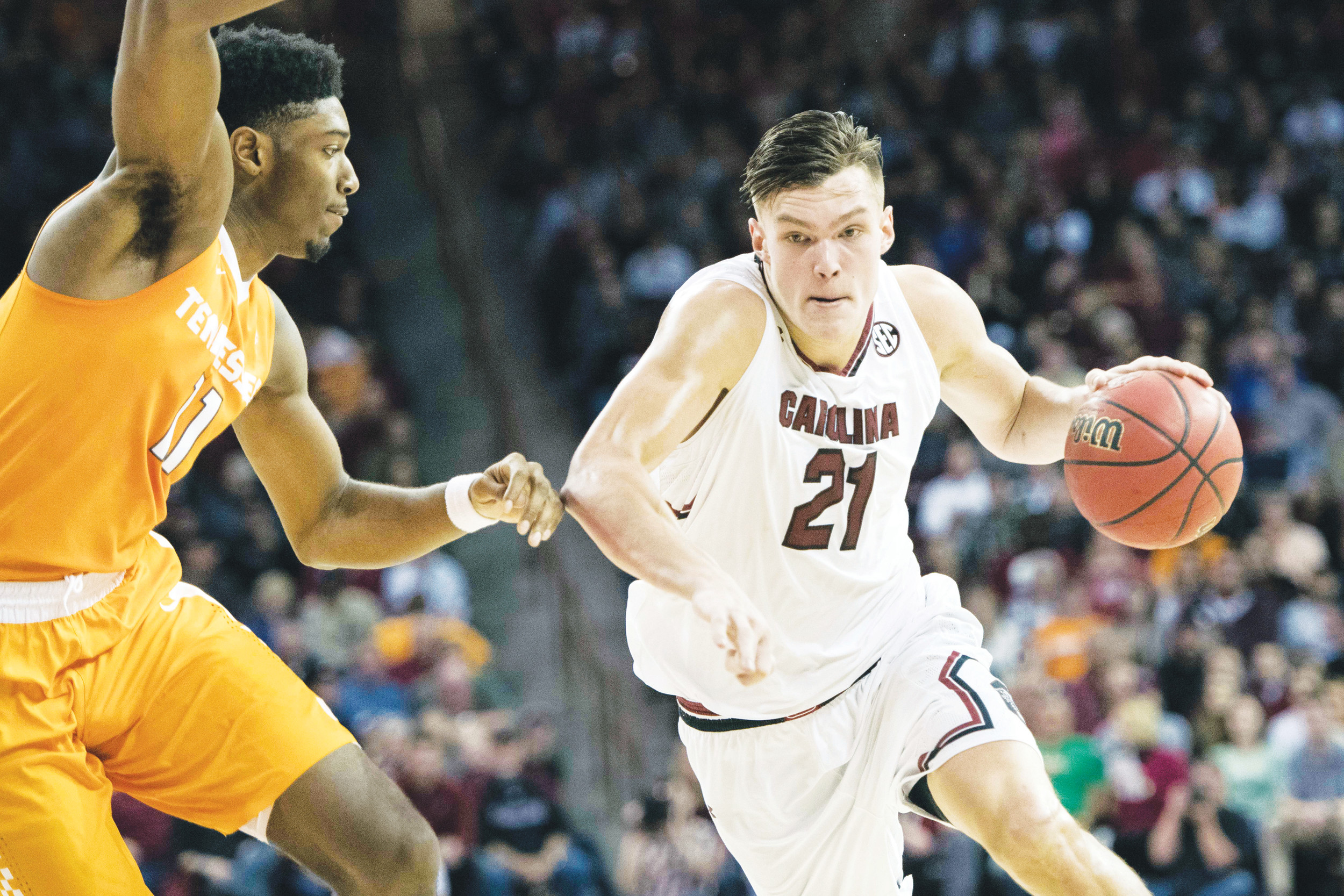 South Carolina forward Maik Kotsar (21) drives to the hoop against Tennessee forward Kyle Alexander (11) during the first half of the Volunteers' 70-63  victory over the Gamecocks on Saturday in Columbia.