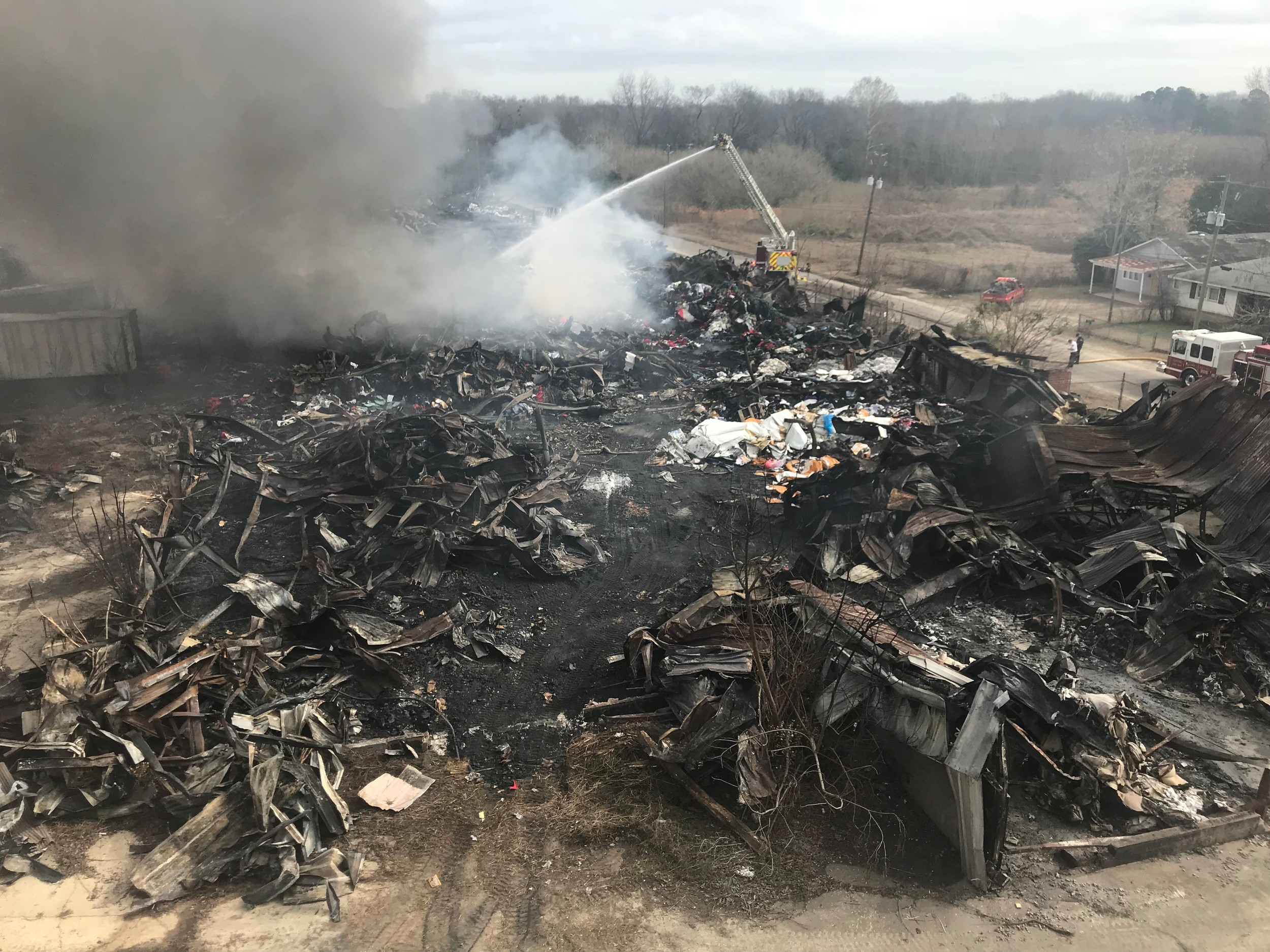 Materials still in the rubble of the warehouse that burned on Friday in Sumter are reigniting hot spots.