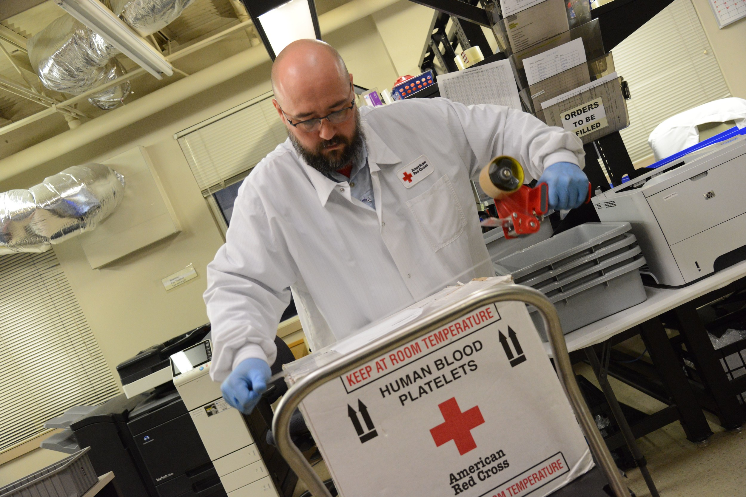 Photo by Daniel Cima for The American Red CrossRed Cross employee Bob Otwell prepares blood products including FFP, Whole Blood and Platelets for distribution to nearby hospitals on Aug. 27, 2017, in Houston, Texas.