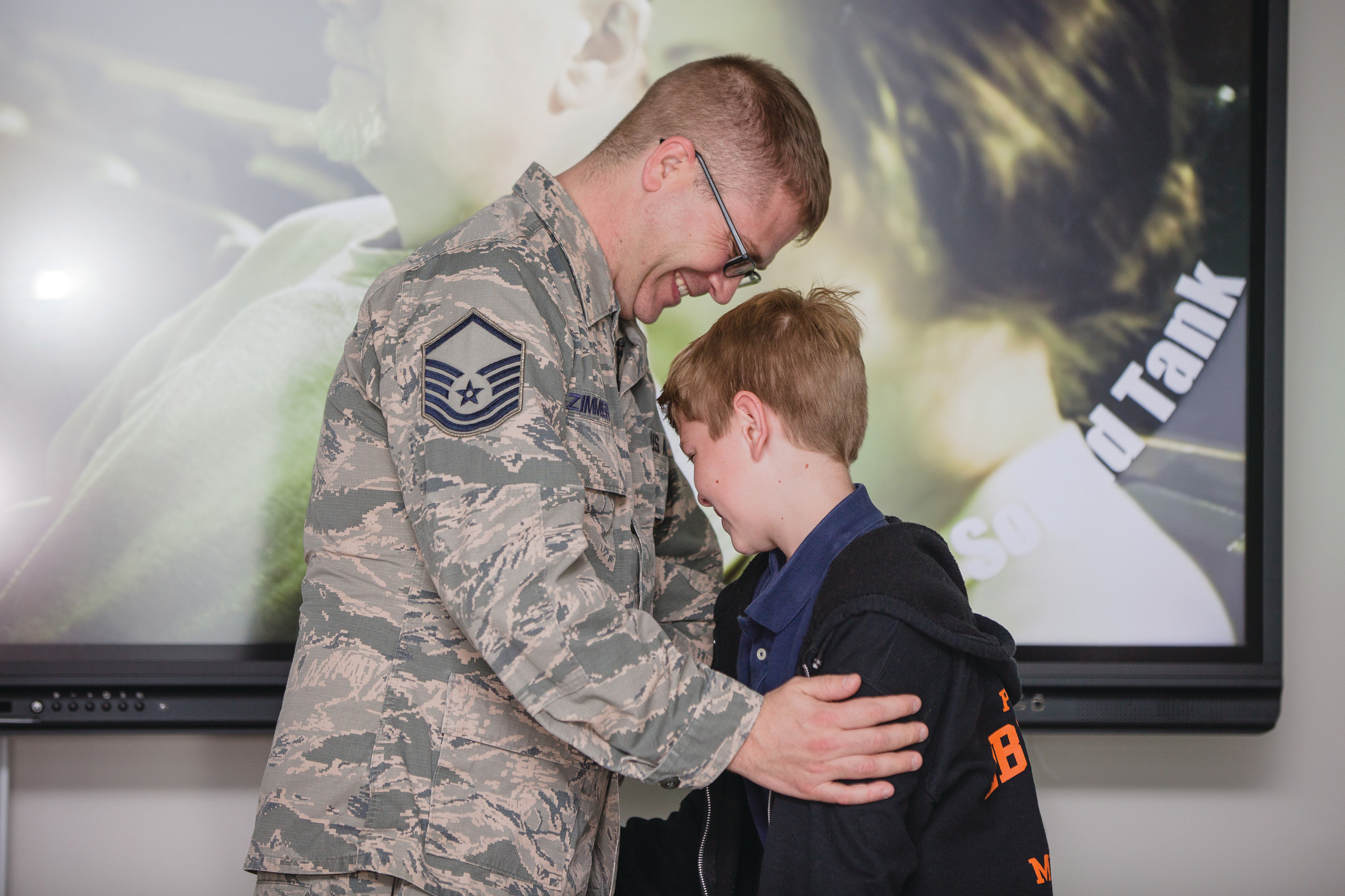 Immediately after suprising him by coming back from deployment a few weeks early, M. Sgt Steven Zimmerman hugs his youngest son, Karson, at Ebenzer Middle School Wednesday afternoon.