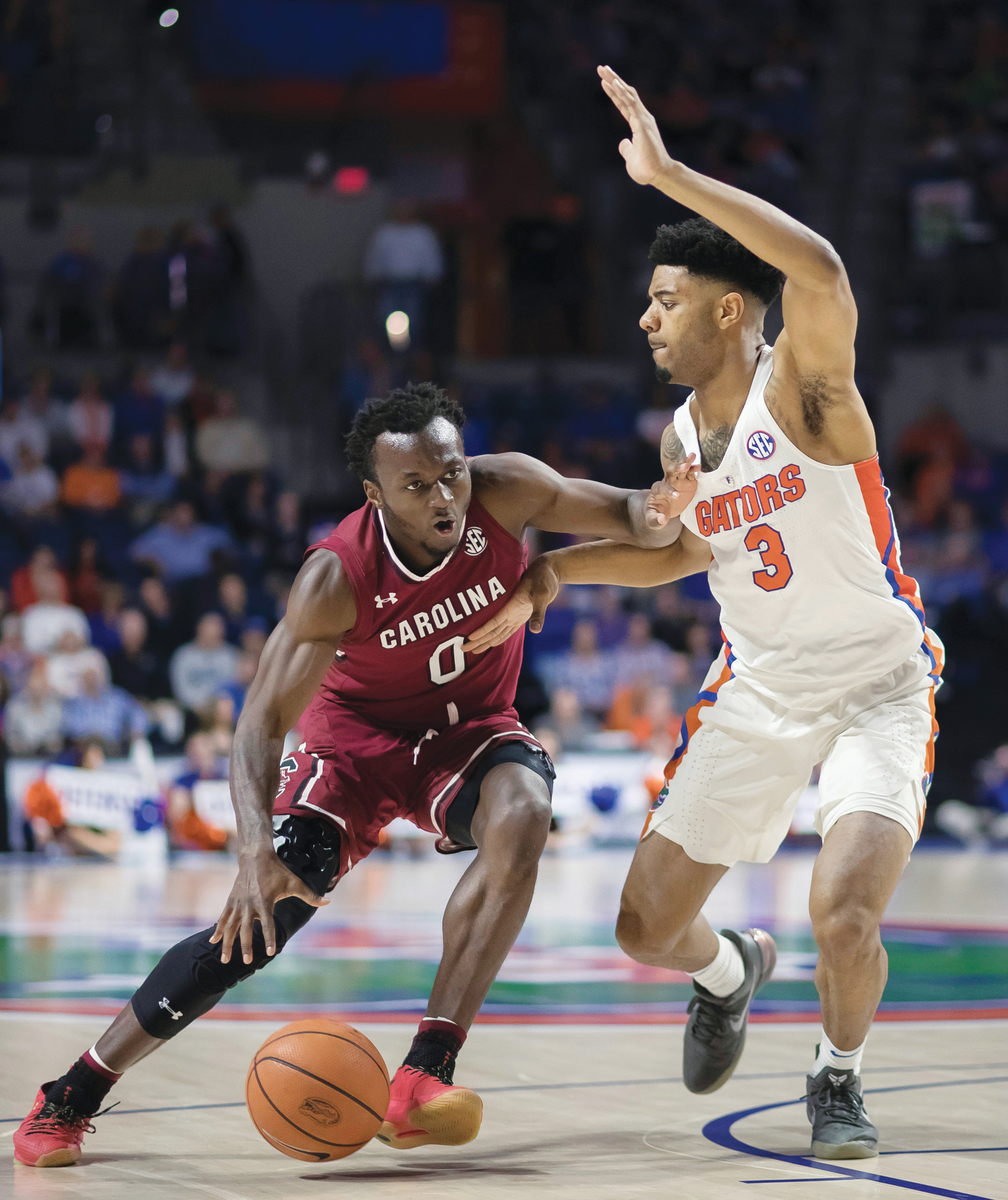 South Carolina's David Beatty (0) dribbles against Florida's Jalen Hudson (3) during the Gamecocks' 77-72 victory on Wednesday in Gainesville, Florida.