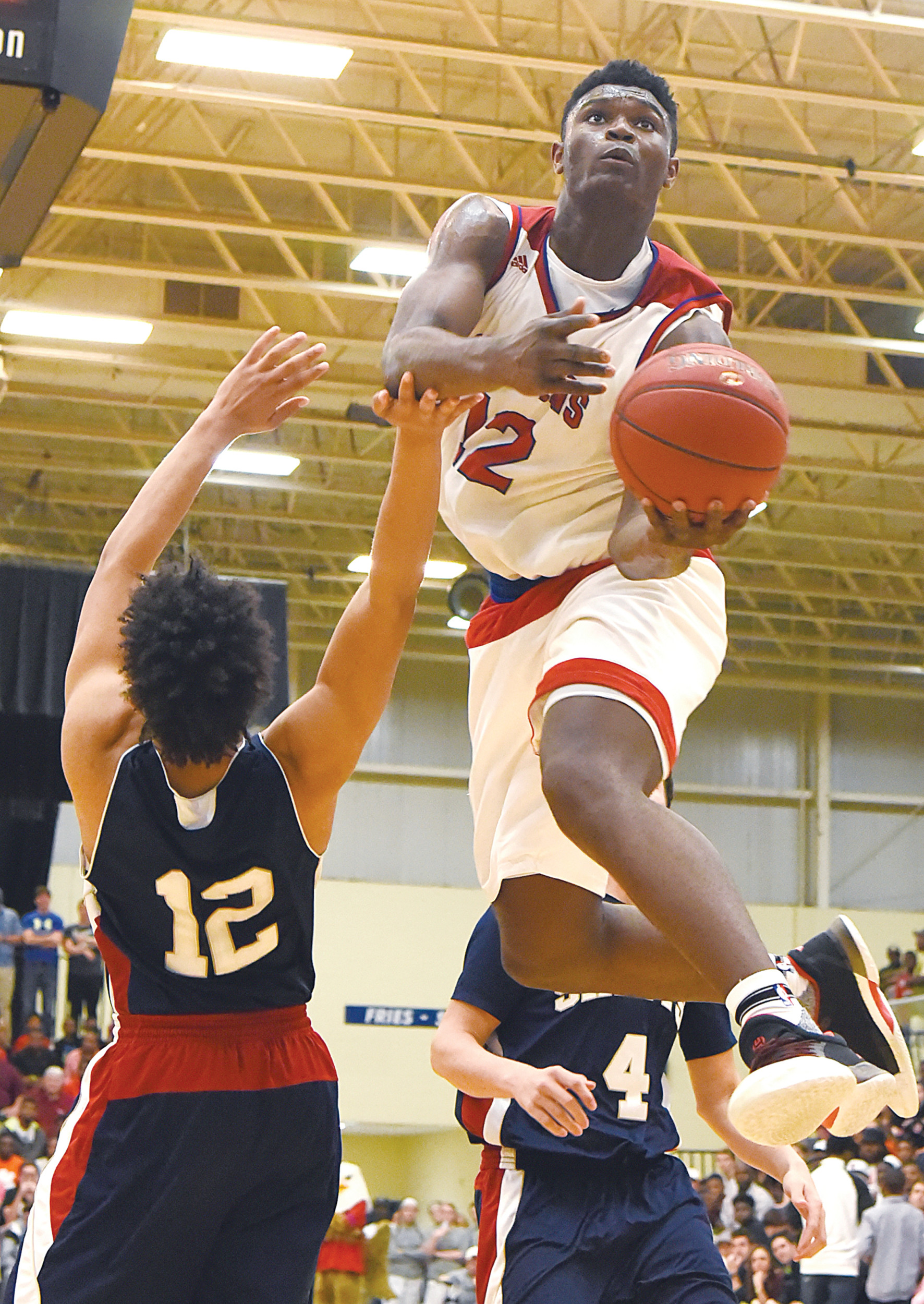 Spartanburg Day's Zion Williamson (12) flies in for a shot over Christian Academy's Jaylen Matthews (12) during last year's SCISA 2A state basketball tournament at the Sumter County Civic Center. Williamson and the Griffins won the title. RIGHT: Williamson winds up for a monster dunk, a scene sure to repeat itself at this year's tournament, which gets underway on Feb. 16.