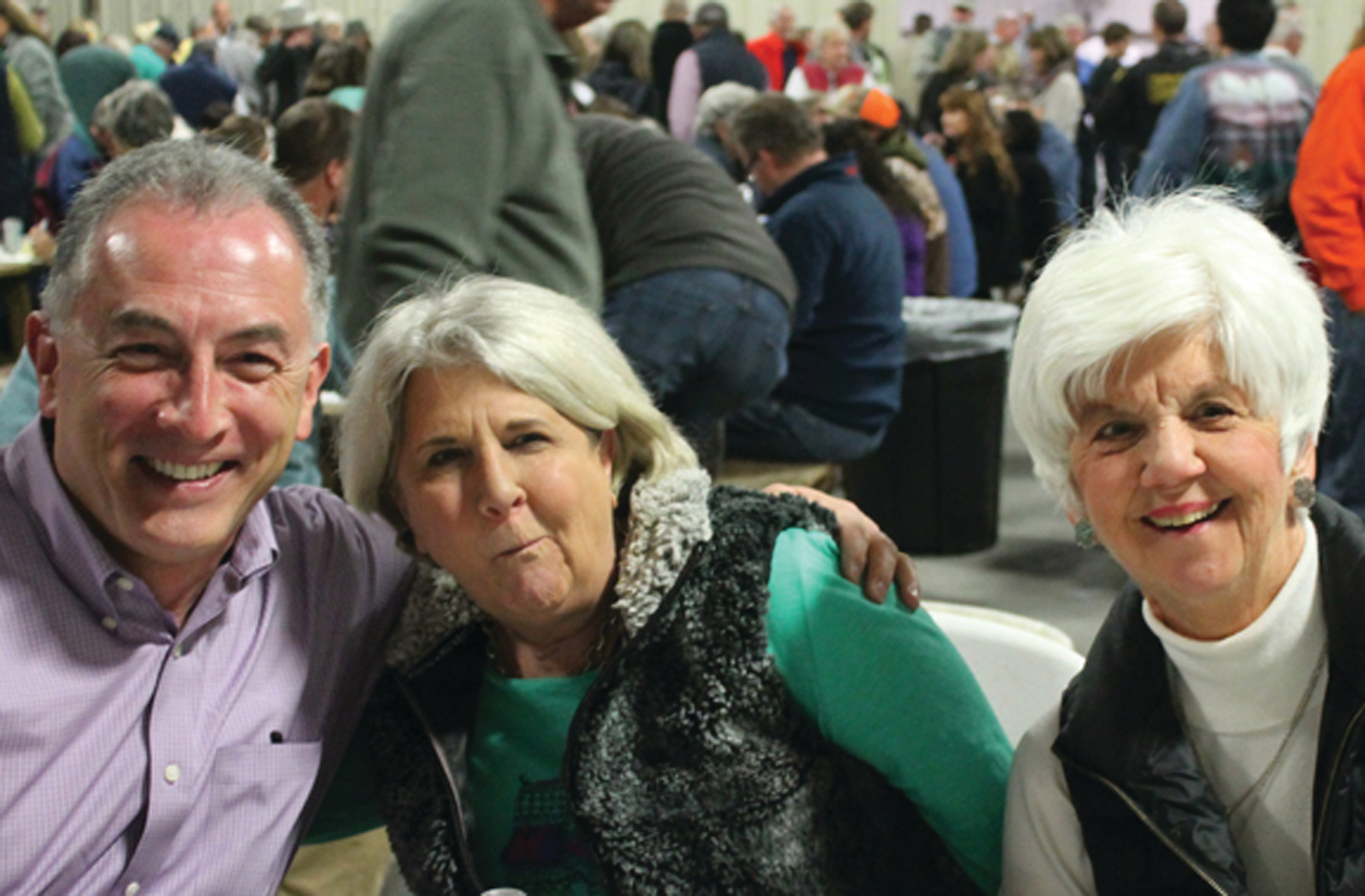Adam Ramirez had his first taste of catfish stew, chicken bog and oysters right out of the shell at the Jan. 20 St. Matthias Oyster Roast. New York resident Ramirez had two locals, Mary Taylor, center, and Betty Coffey introducing him to various Southern cuisines.