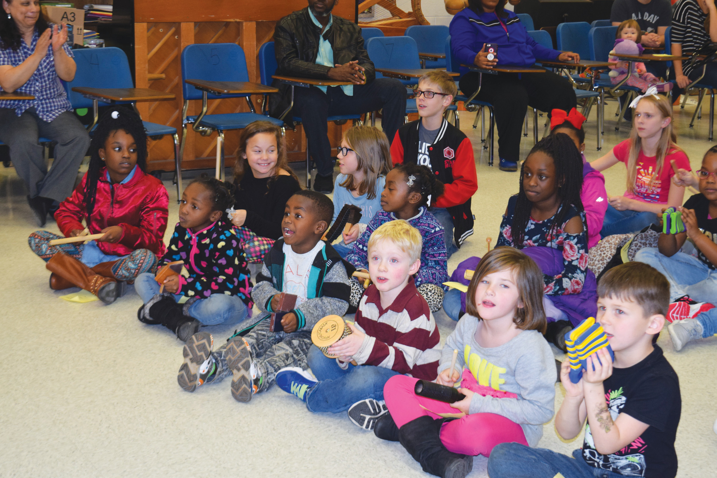 "PHOTOS PROVIDEDChildren sing along and play instruments to Pete the Cat's ""I Love My White Shoes"" song at Kingsbury Elementary School's annual Family Reading Night."