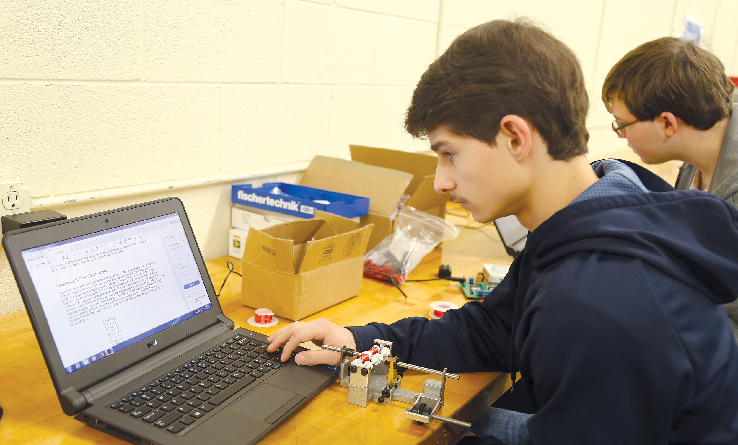 Sumter High School junior Blake Parnell reads instructions from a laptop on motor construction on Thursday at Sumter Career and Technology Center.
