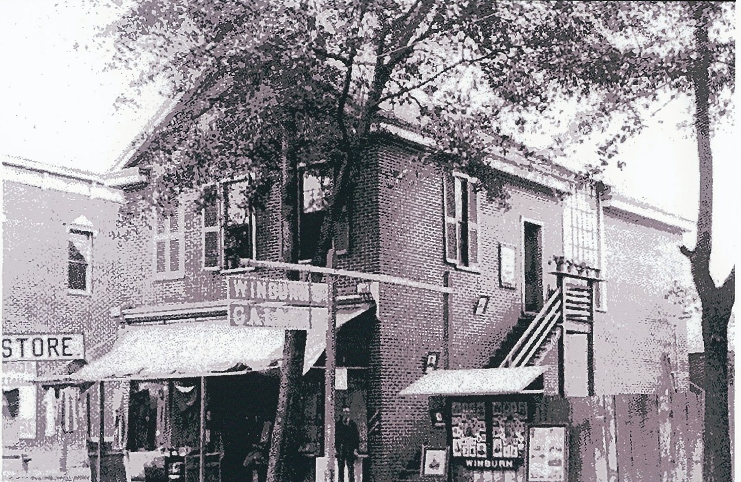 Winburn's Photograph Gallery is seen. J. H. Winburn's gallery chronicled the growth of Sumter.