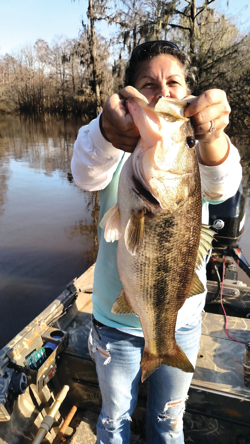 Michelle Nunnery caught her first big bass fishing in Sparkleberry Swamp. The fish weighed 10 pounds.