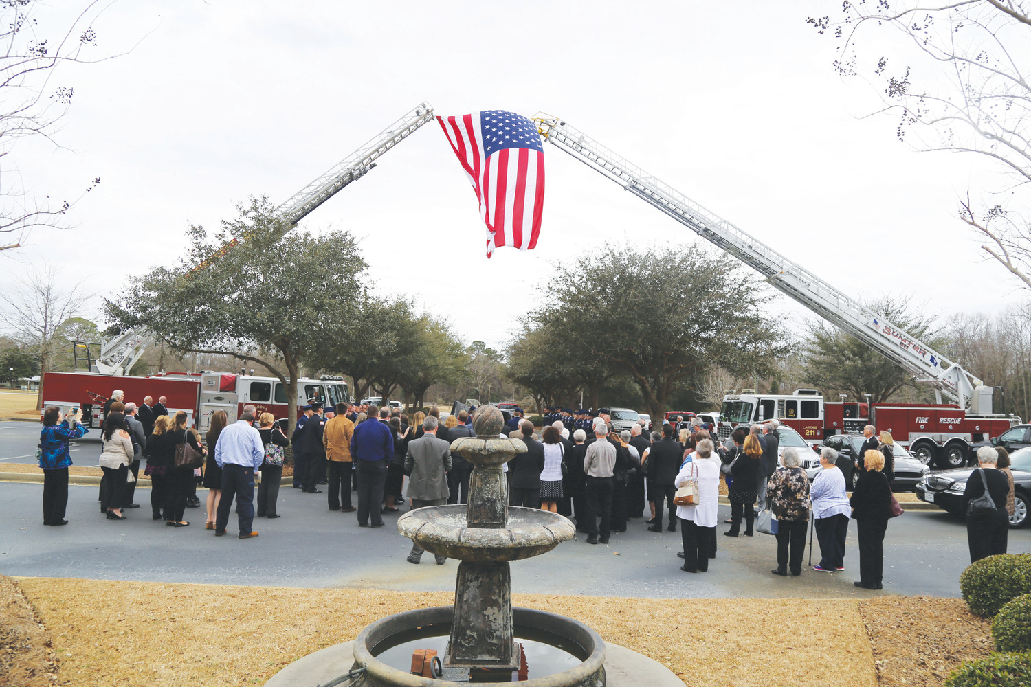 An American flag is displayed during the funeral of former fire Chief Don Spitzer. Shaw Fire Department and Sumter Fire Department attended the funeral that included Fire Department Honors at First Church of God on Saturday.