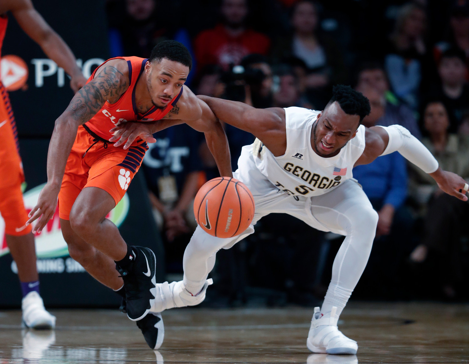 ASSOCIATED PRESS Clemson guard Marcquise Reed (2) steals the ball from Georgia Tech guard Josh Okogie (5) in the second half of the Tigers' 72-70 victory on Sunday in Atlanta.